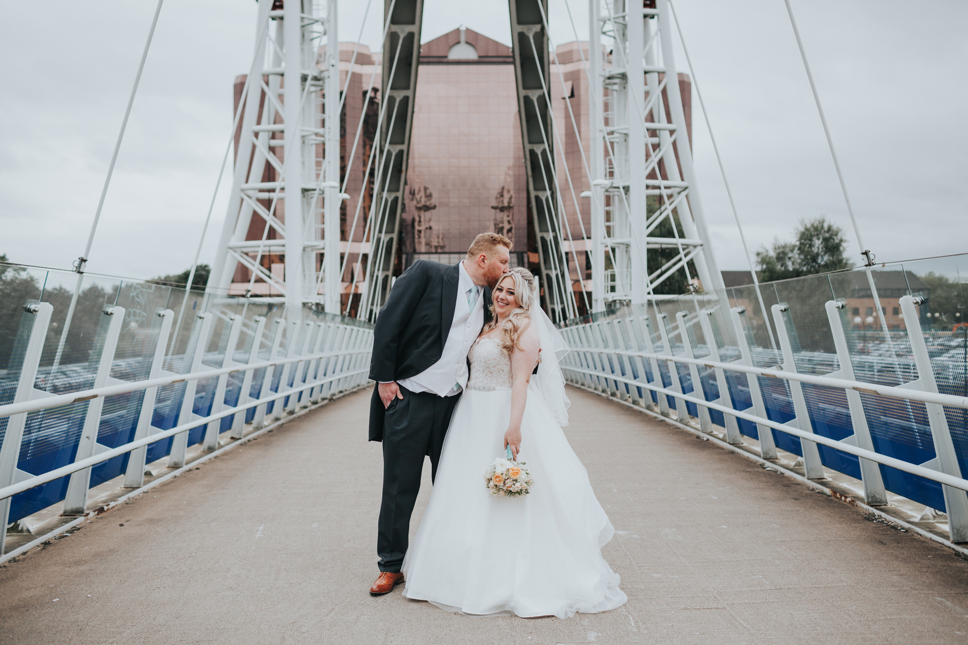 Bride and Groom have a photo on the bridge,