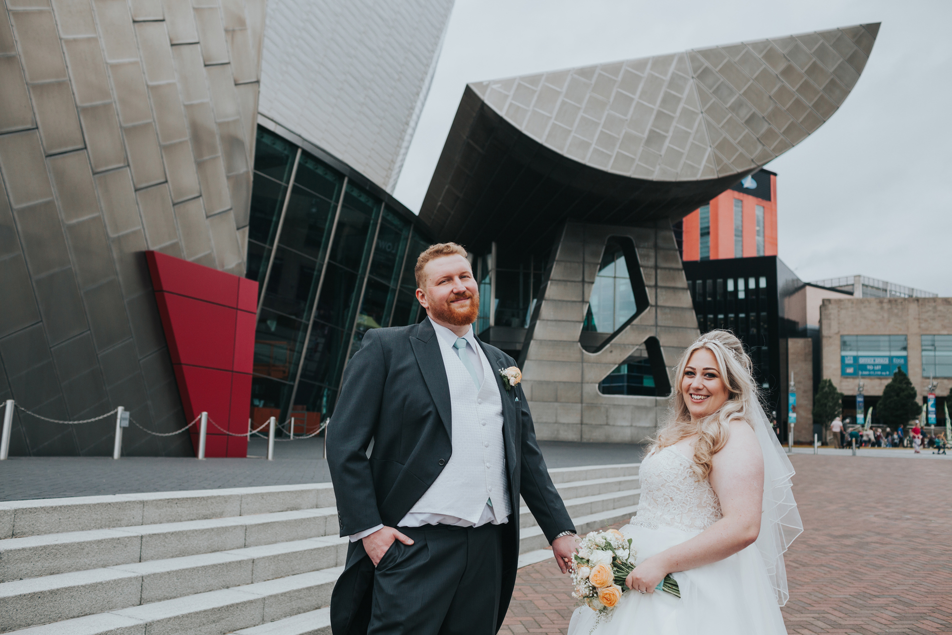 Bride and Groom with The Lowry Theatre behind them.