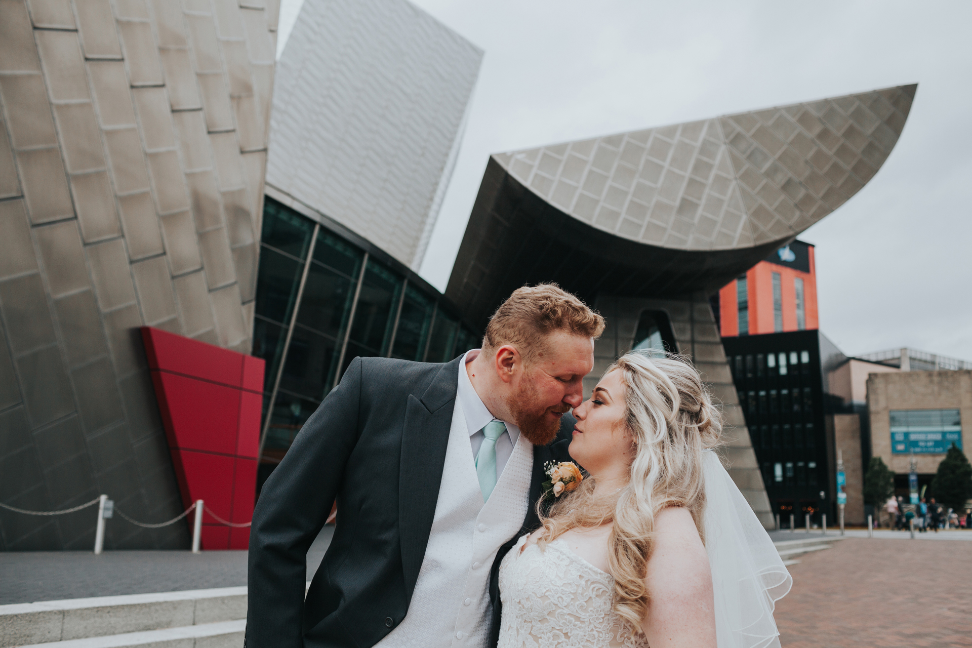 Bride and Groom go nose to nose outside the Lowry Theatre.