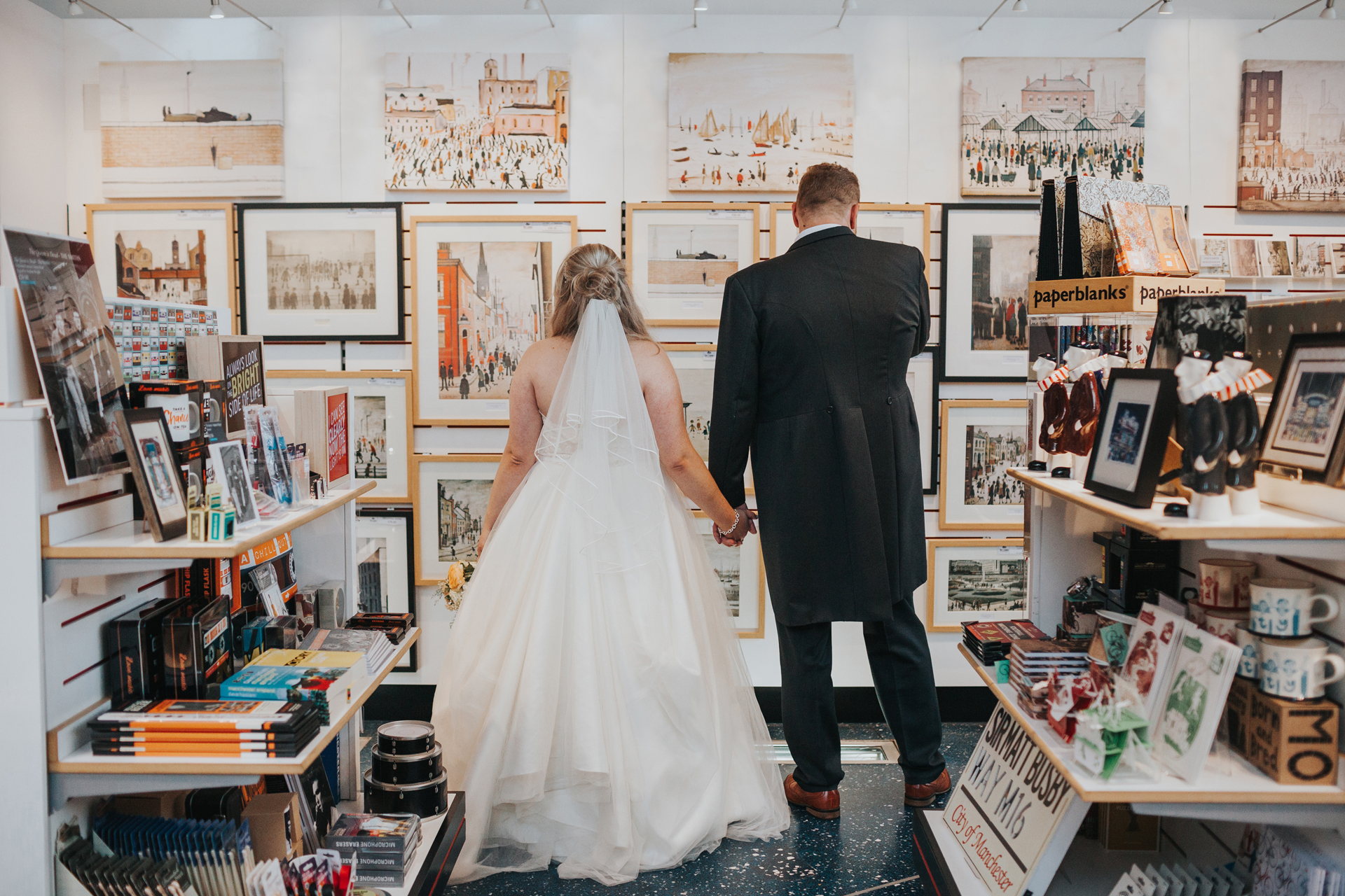 Bride and Groom go shopping in The Lowry Theatre Gift Shop.