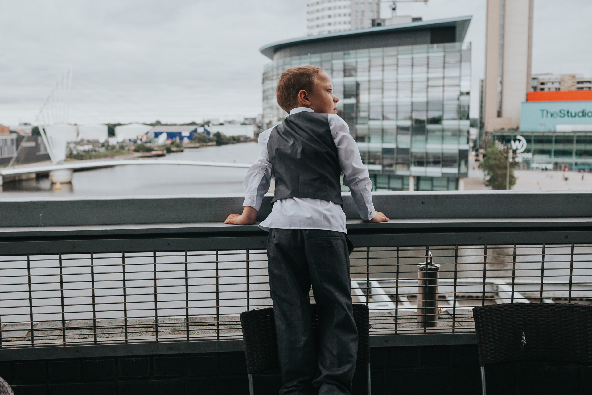 Little boy enjoys the view at The Lowry Theatre.