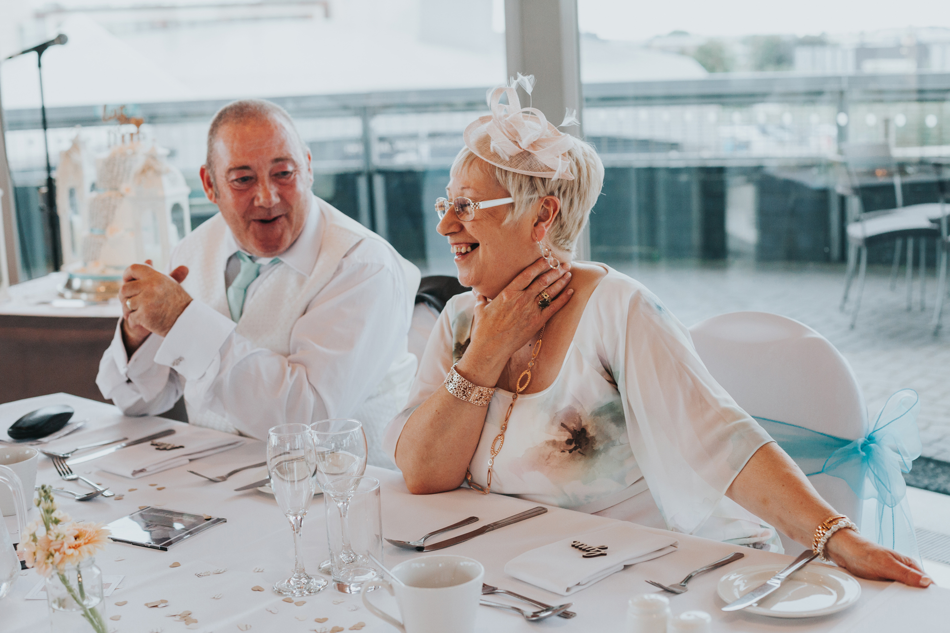Mother of the bride has a laugh with father of the bride.