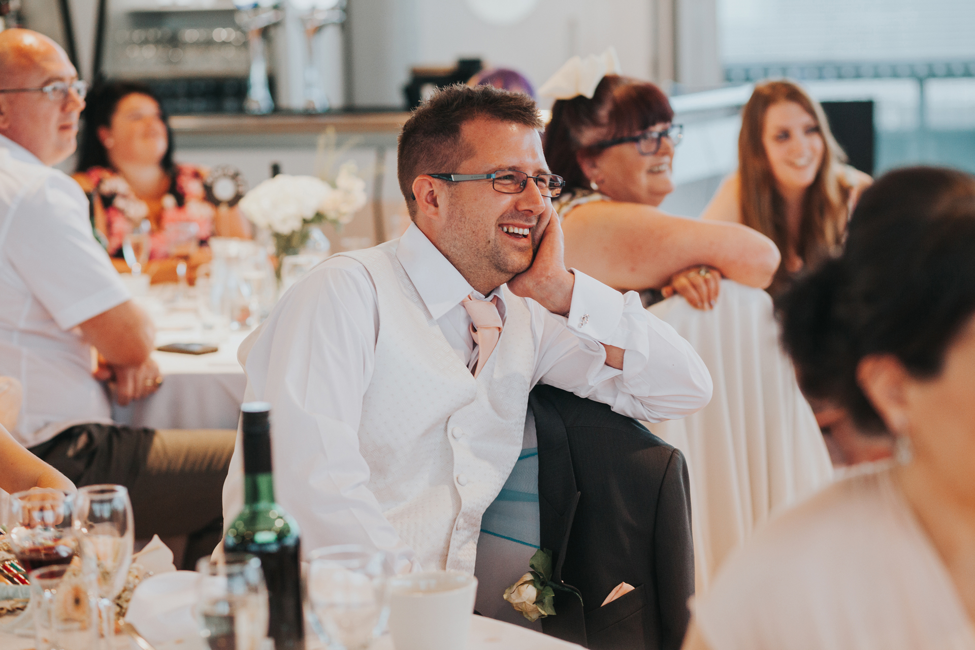 Best Man laughing at Groom's speech.