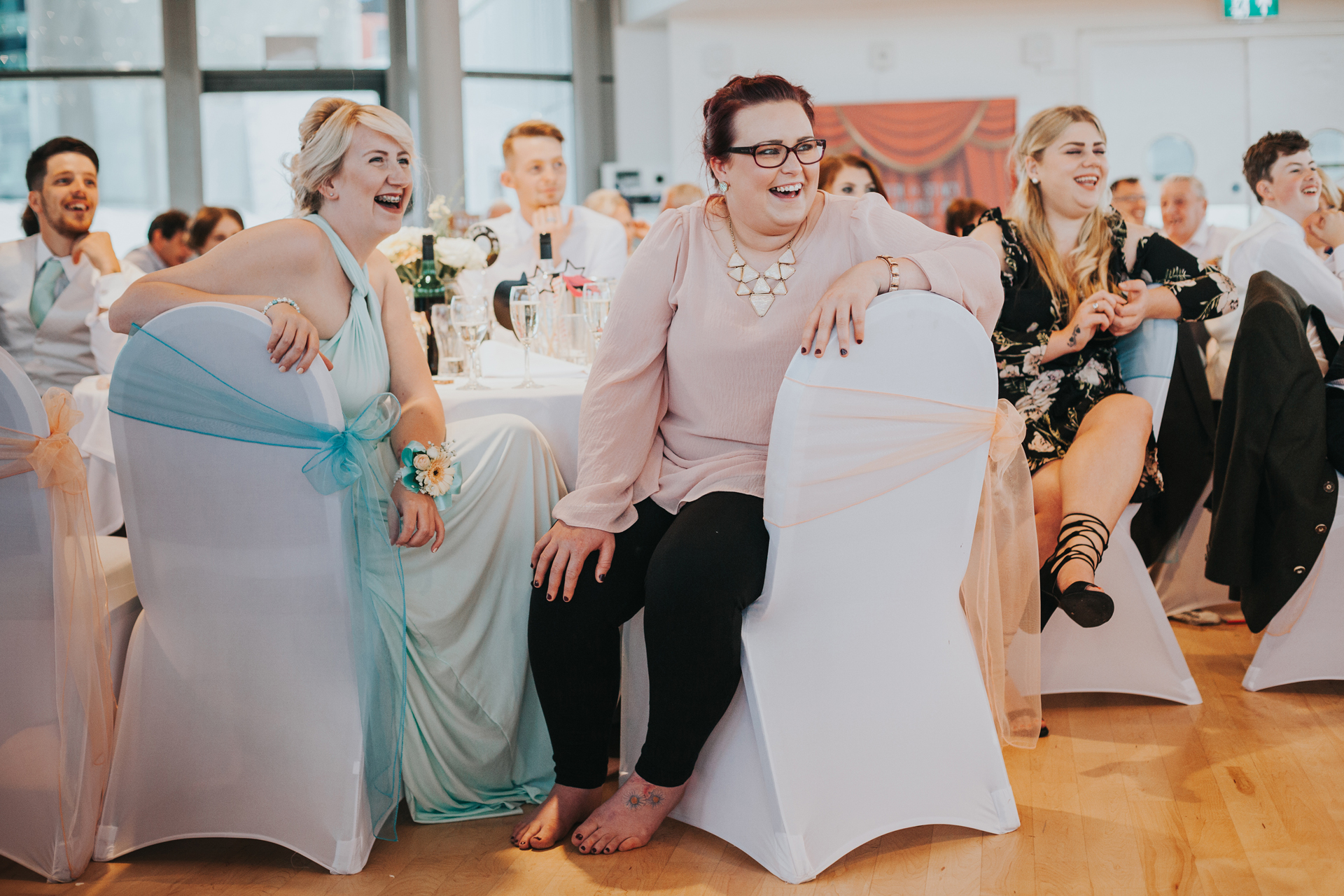 Wedding guests laughing.