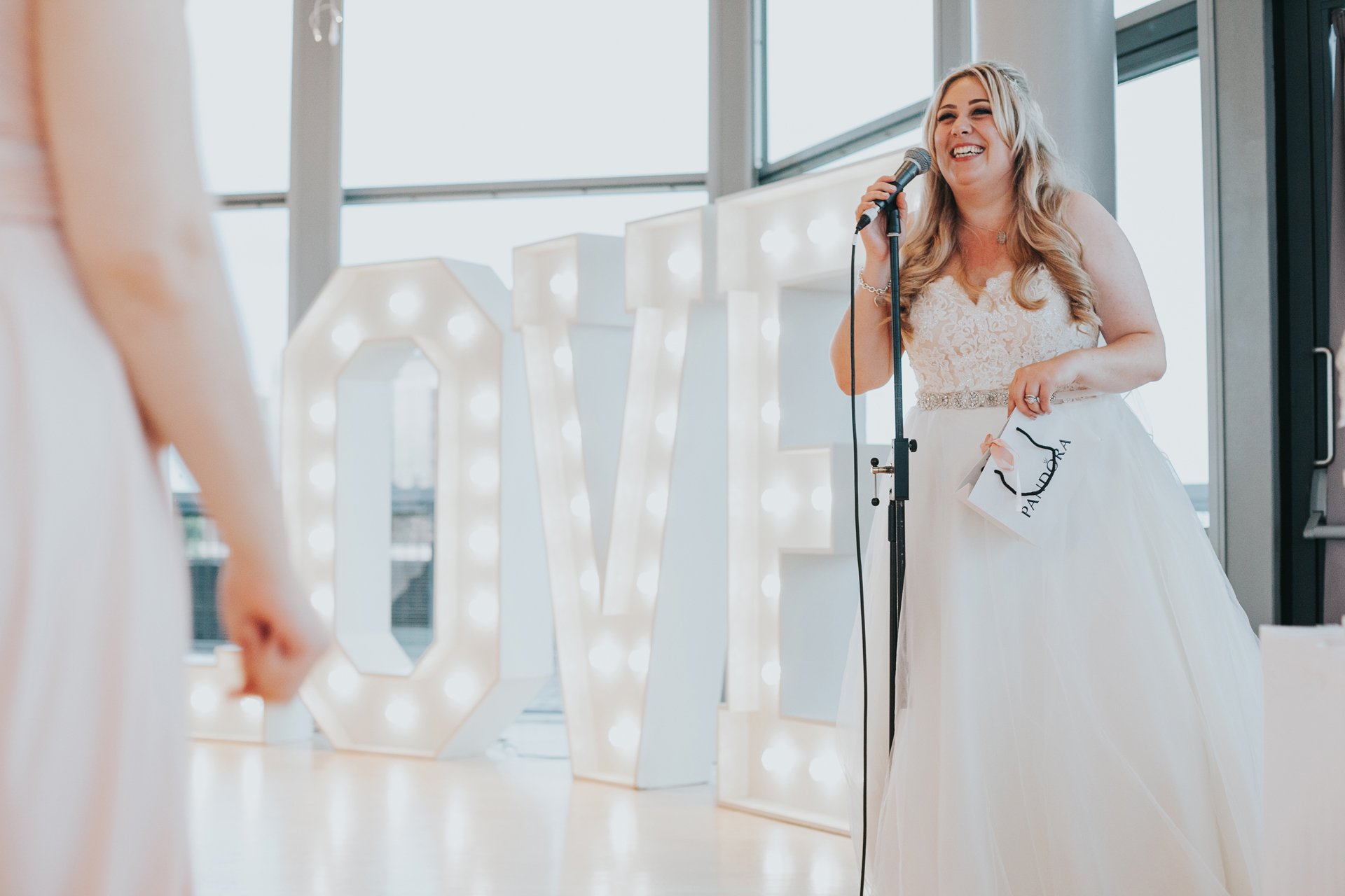 Bride stands up to say thanks yous.