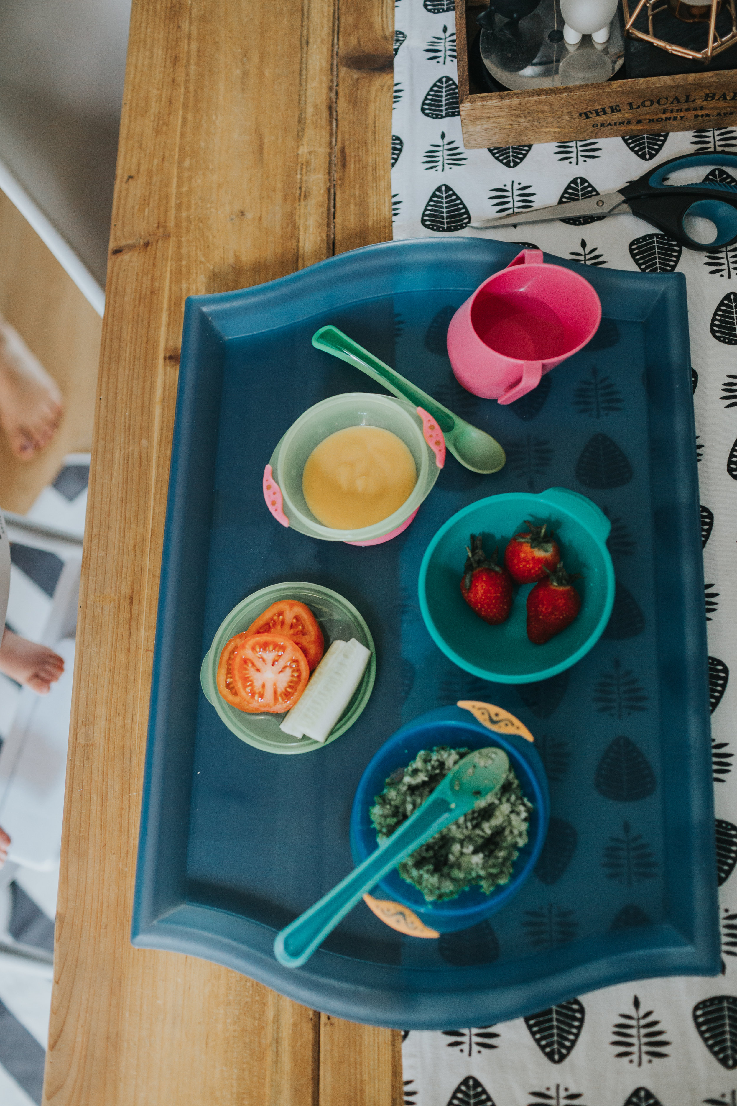 A photo of the babies lunch, strawberries, tomato, pea pure and unknown.