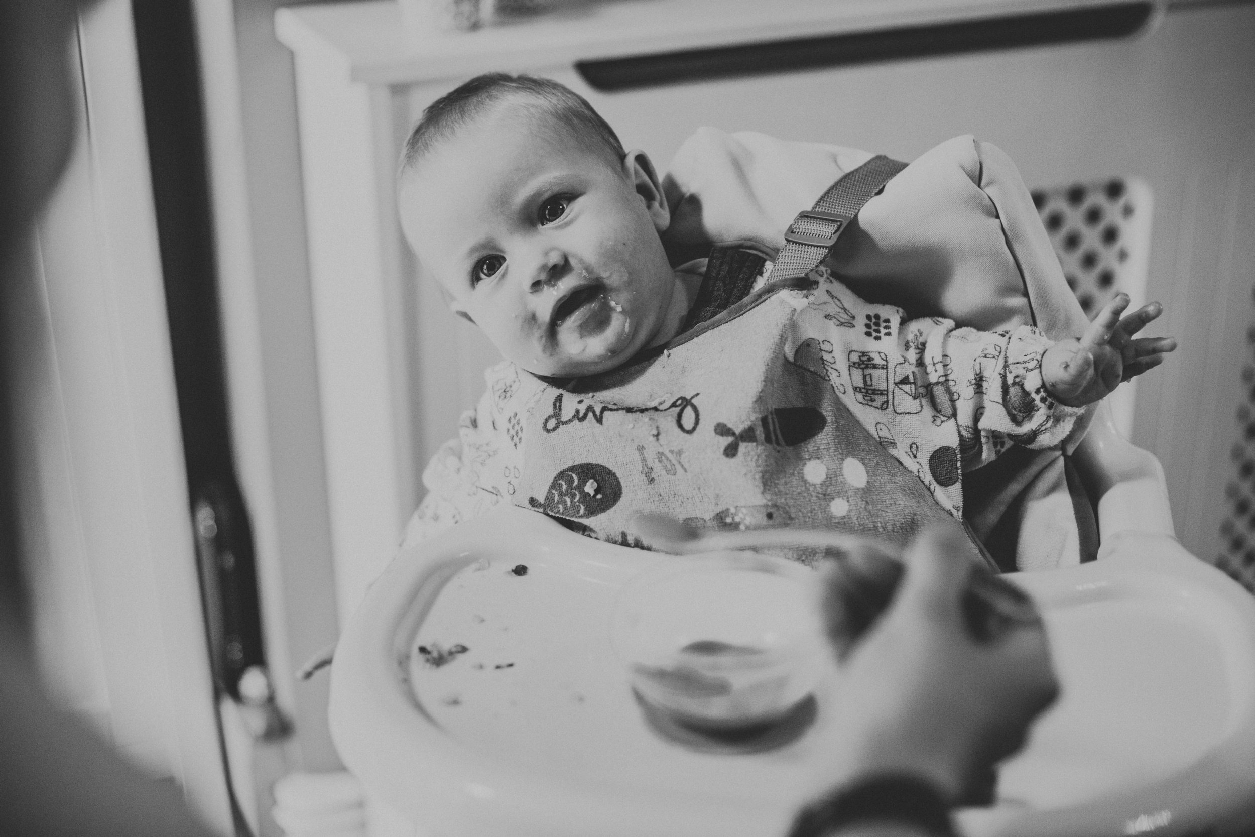 Black and white photo of baby eating.
