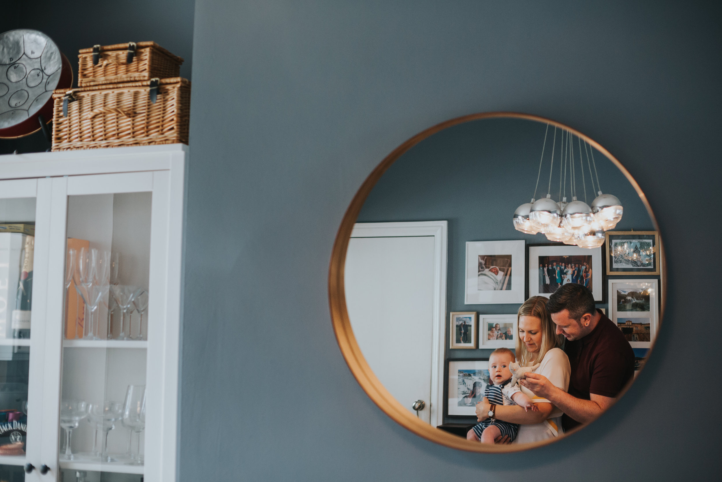 Families reflection in mirror.