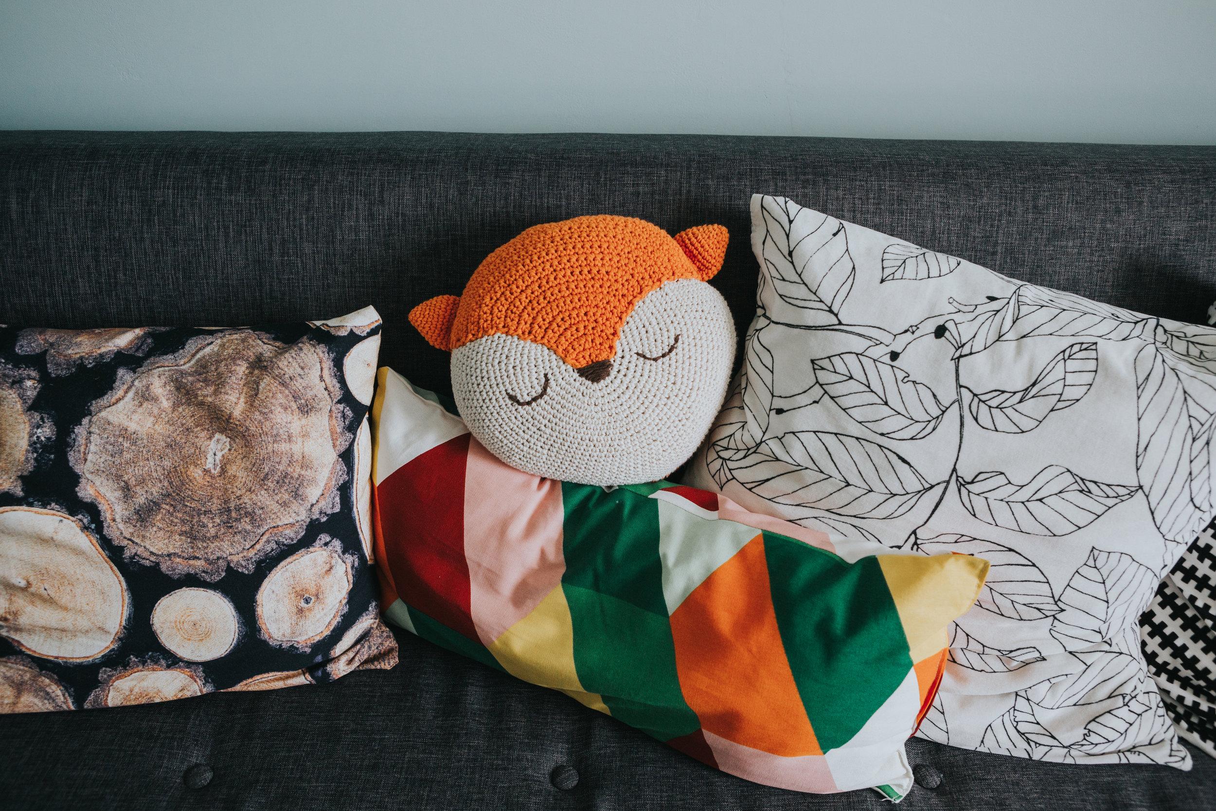Colourful cushions on sofa.