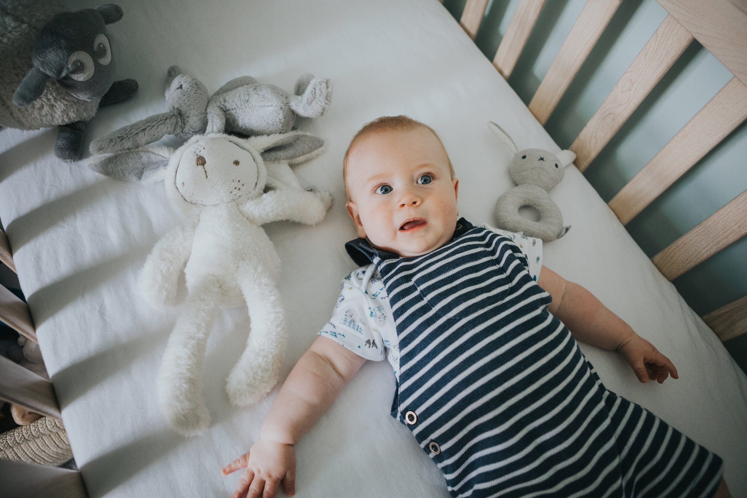 Baby in his cot.