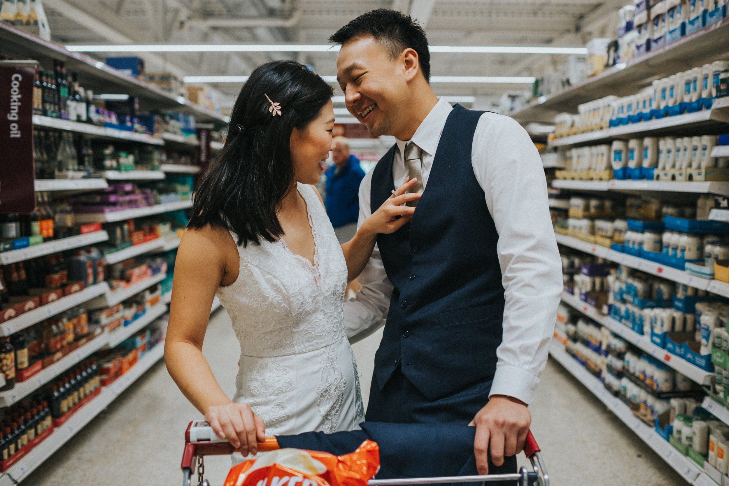 Couple have a moment together in supermarket.