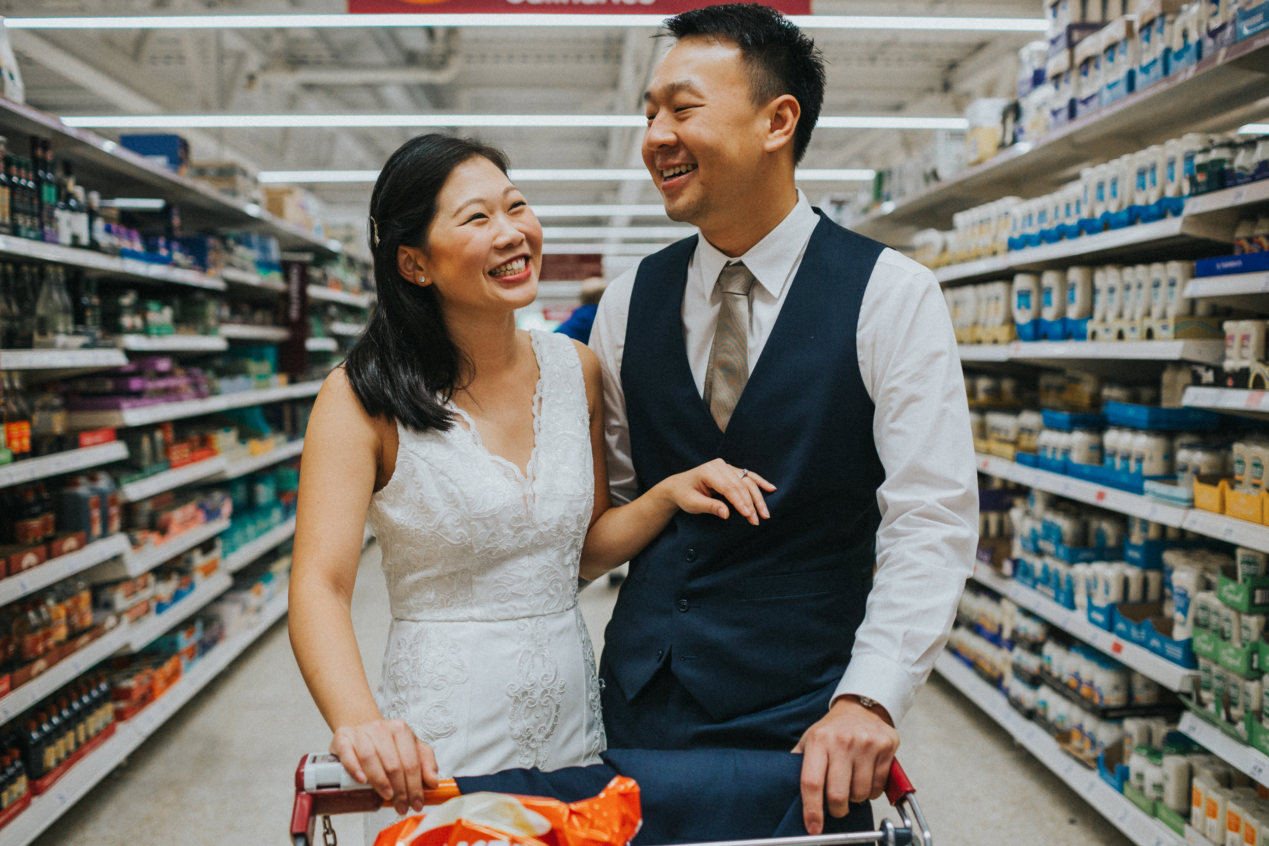 Couple smiling together in supermarket.