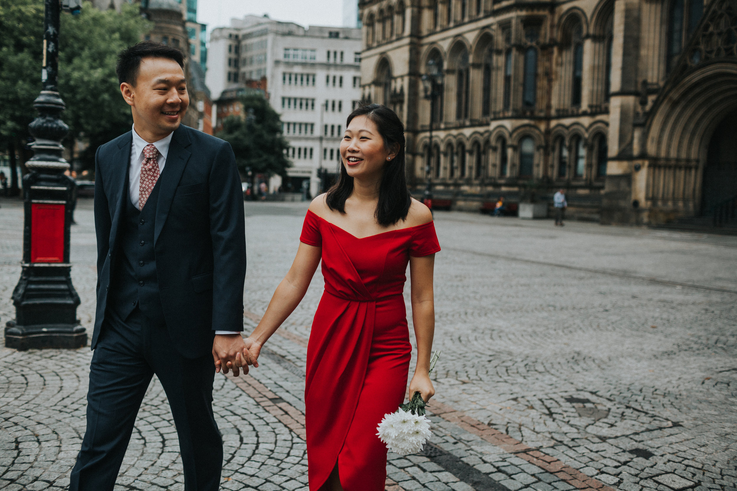 Couple smiling and walking together.