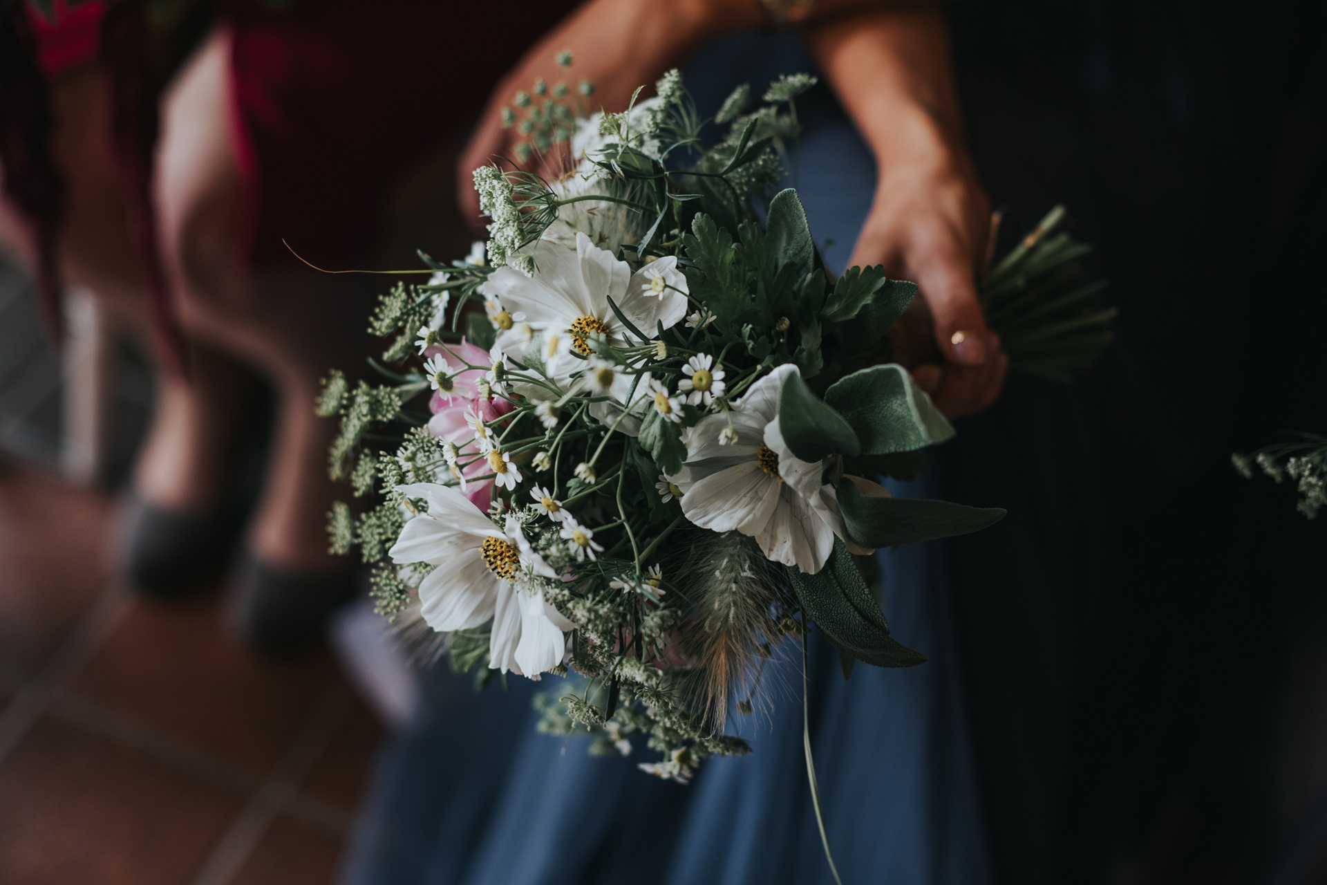 Close up of a bridesmaids bouquet of wild seasonal flowers.