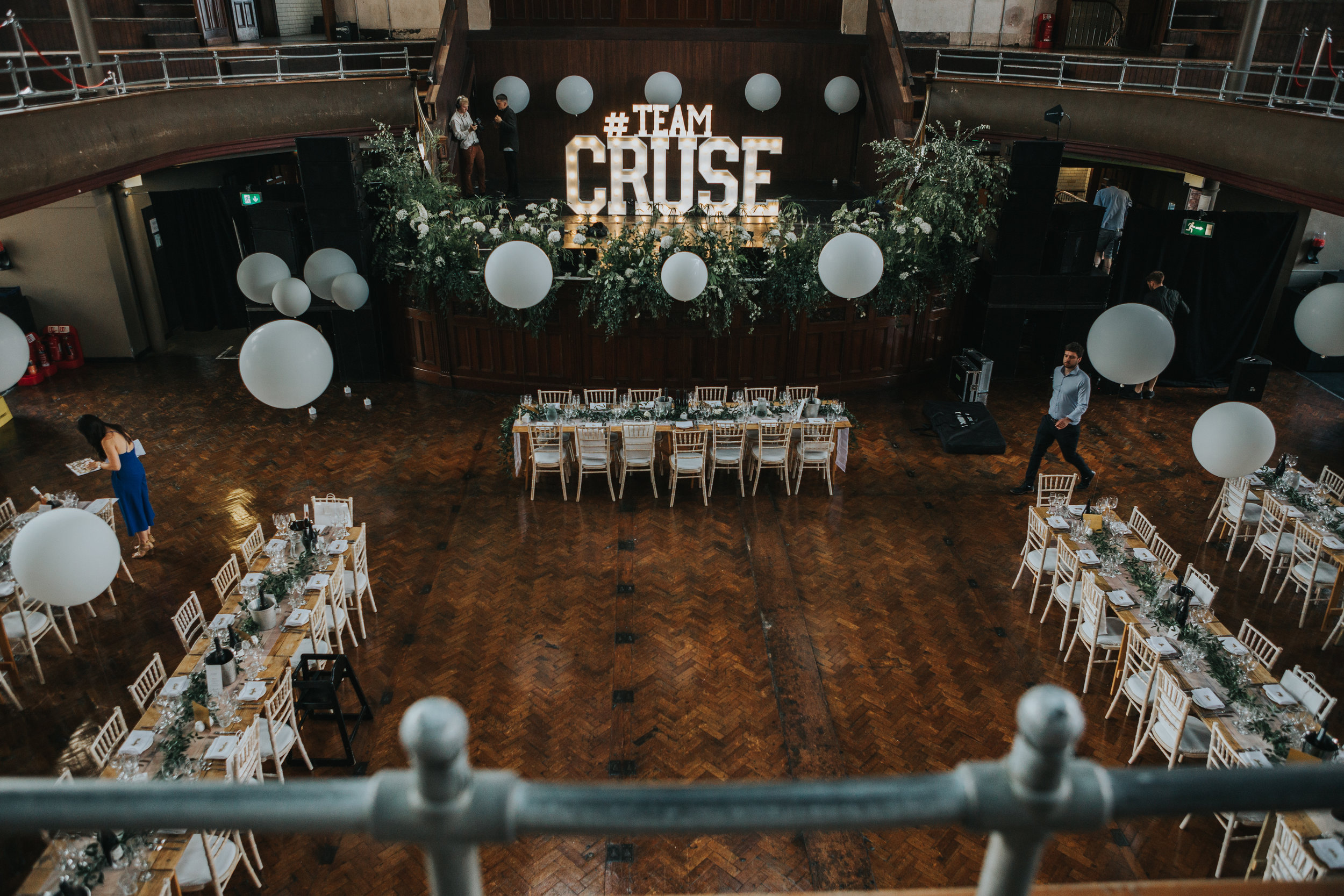Tables are set up with #TEAMCRUSE sign in the middle.