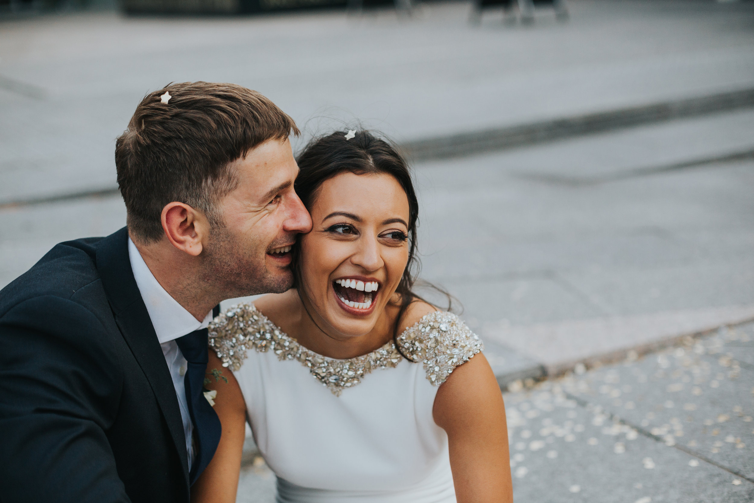 Bride and groom laughing surrounded by glittering stars.