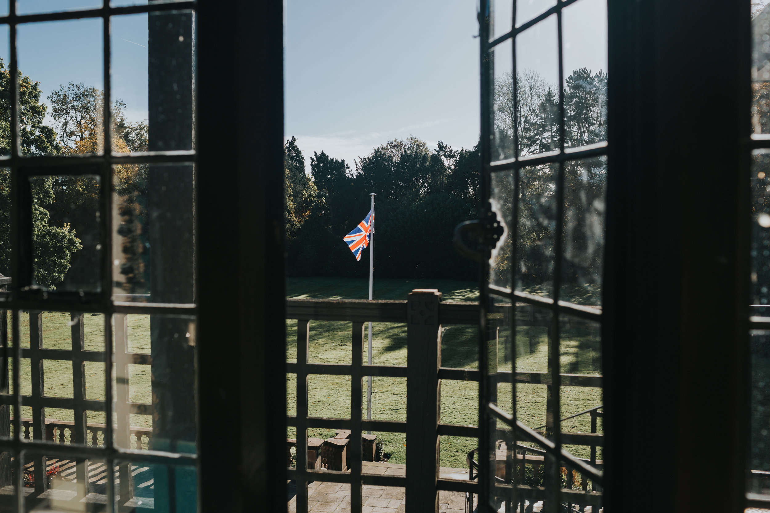 The Union Jack flies outside the hotel room window at Inglewood Manor, the sun is shining.