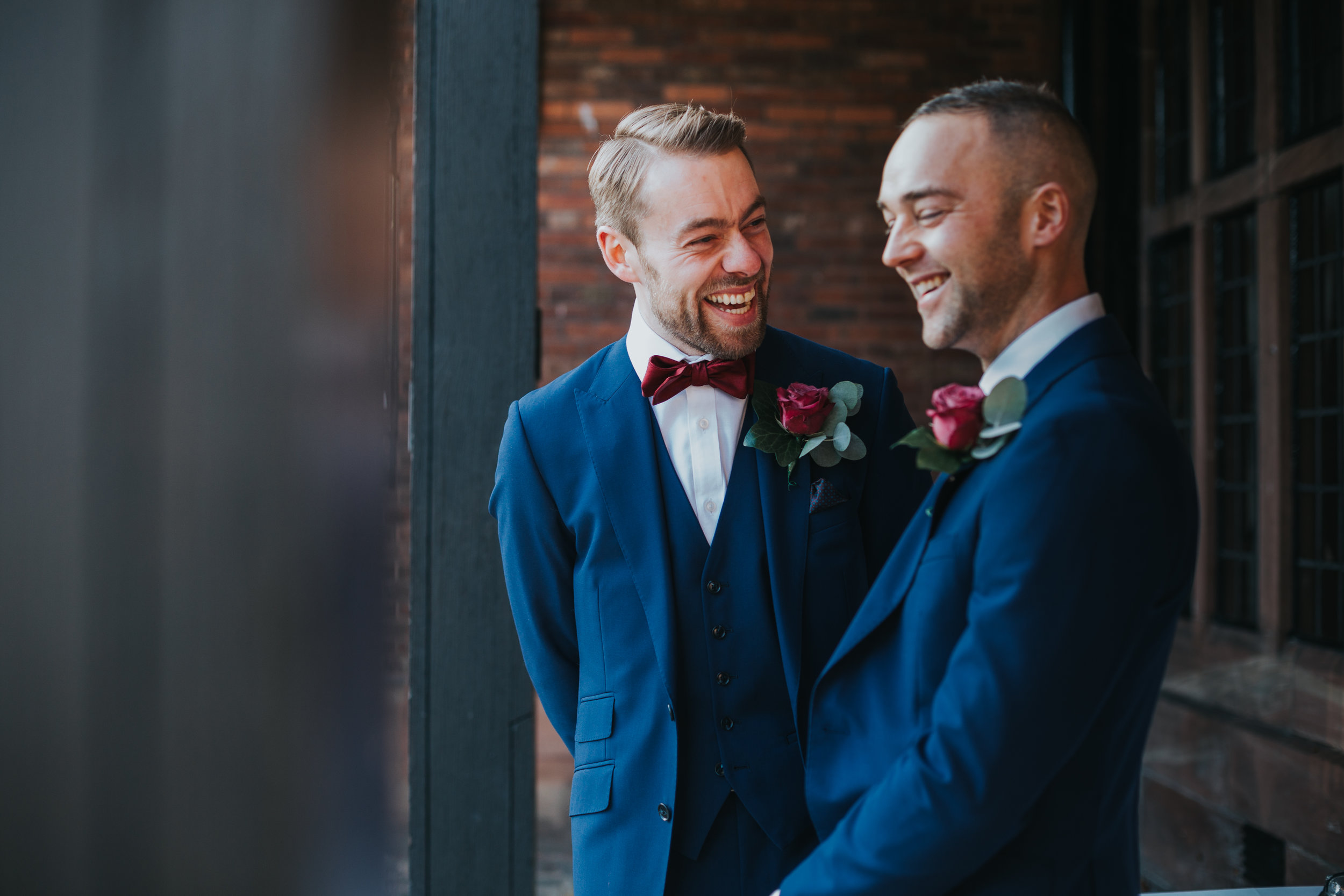 The groom and best man exchange a joke.
