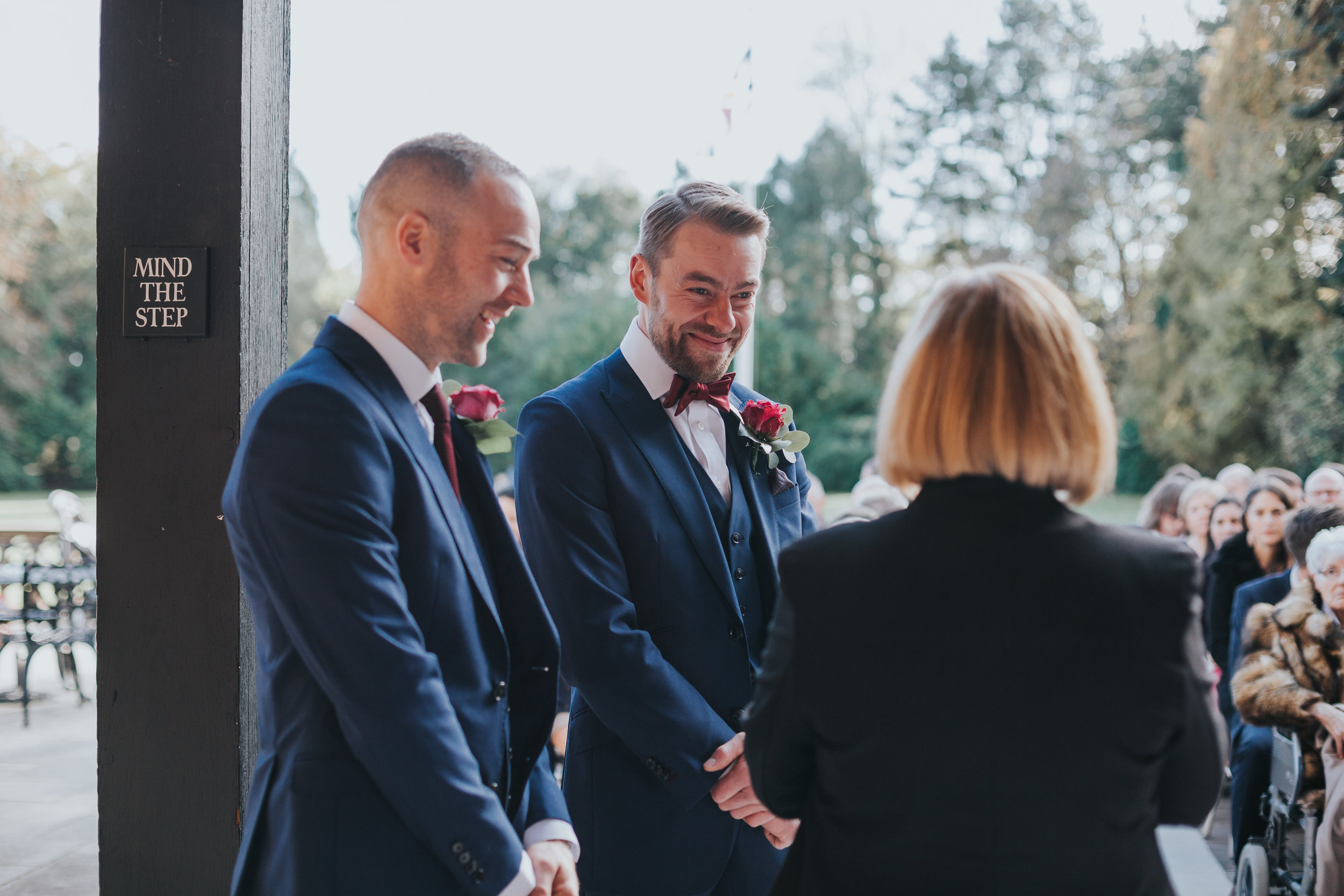 The groom, best man and registrar share a joke.