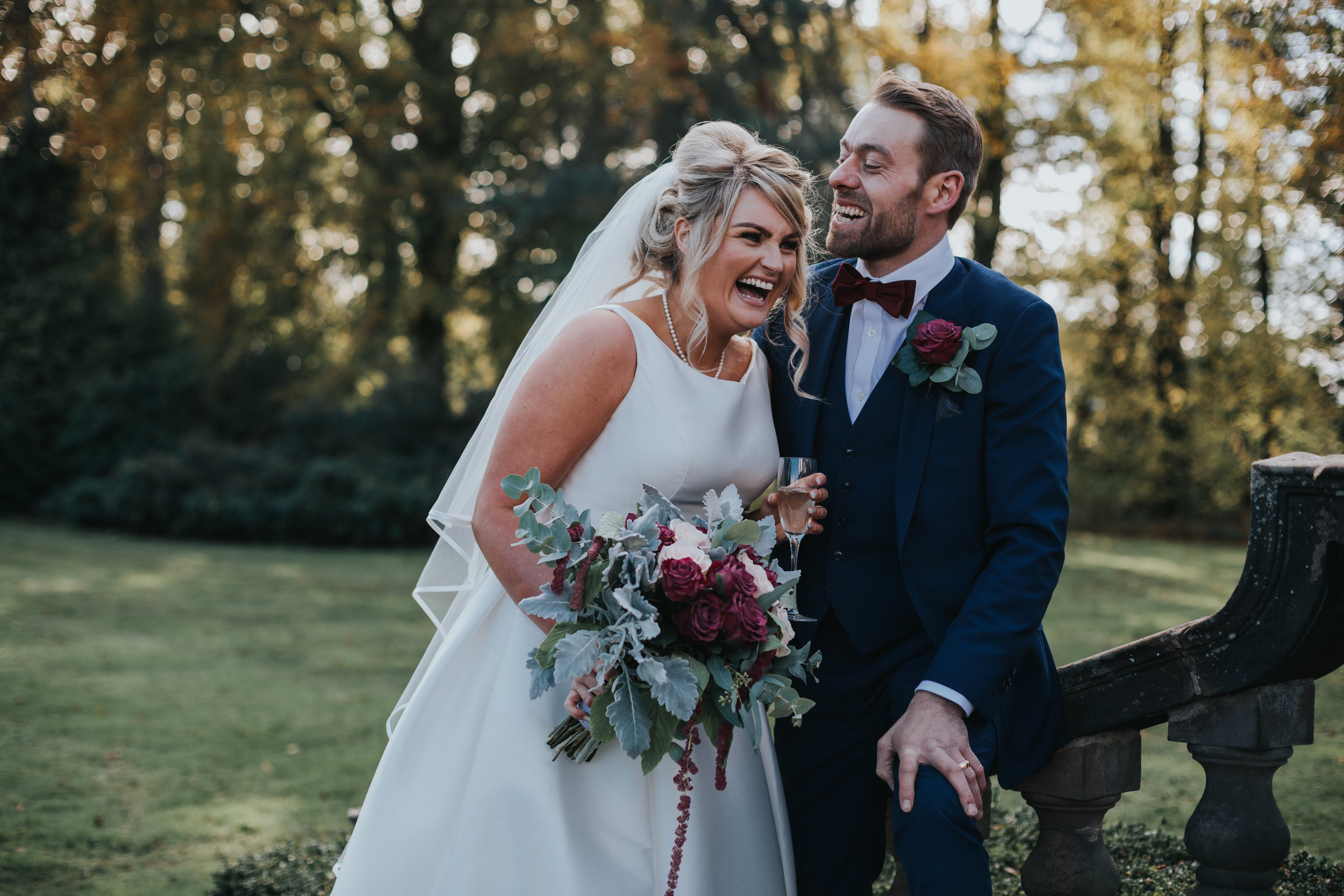 Couple laugh together during their Autumnal wedding at Inglewood Manor.