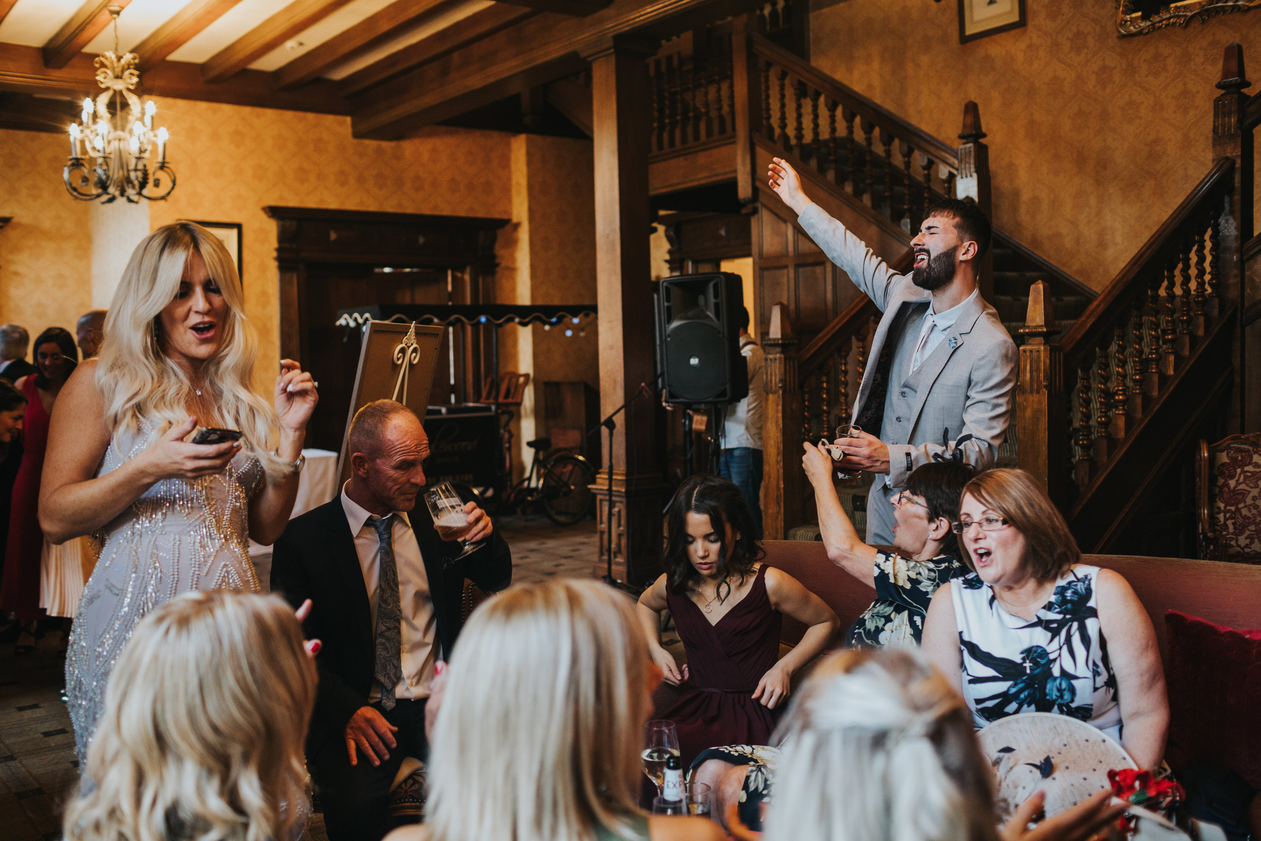 Wedding guests sing together.