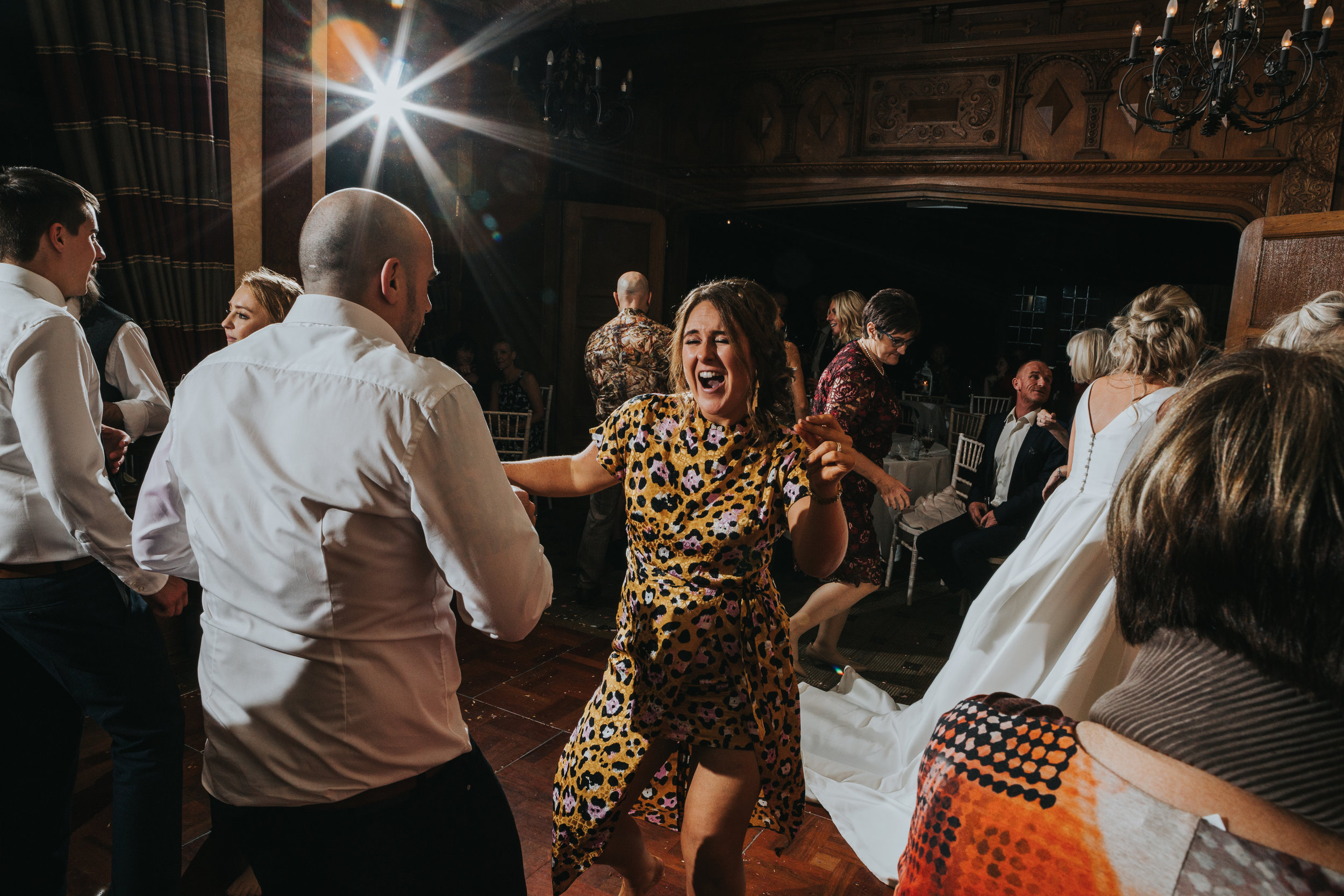 Wedding guest dances with her husband.