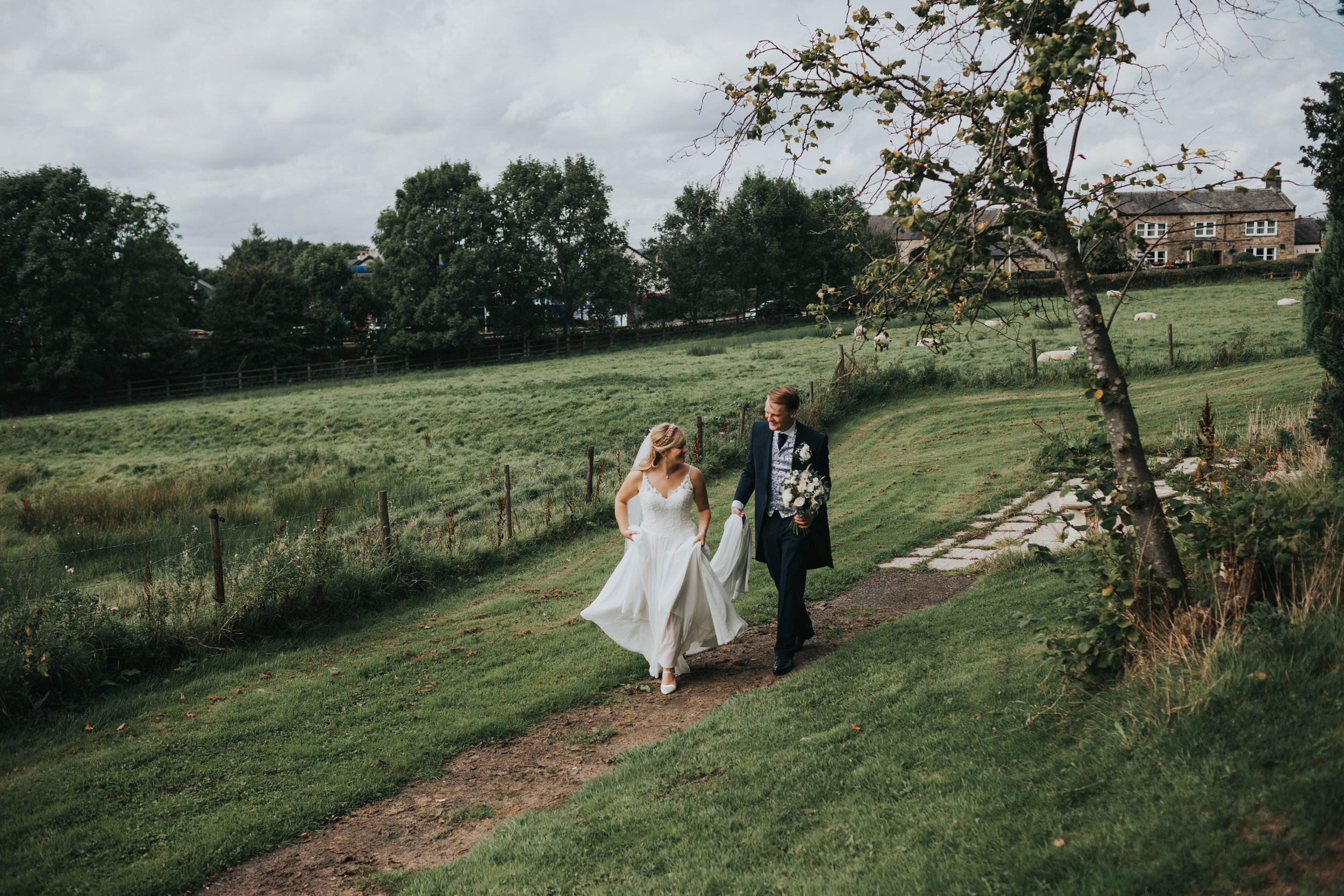 Bride and Groom enjoy a walk together at Mytton Fold