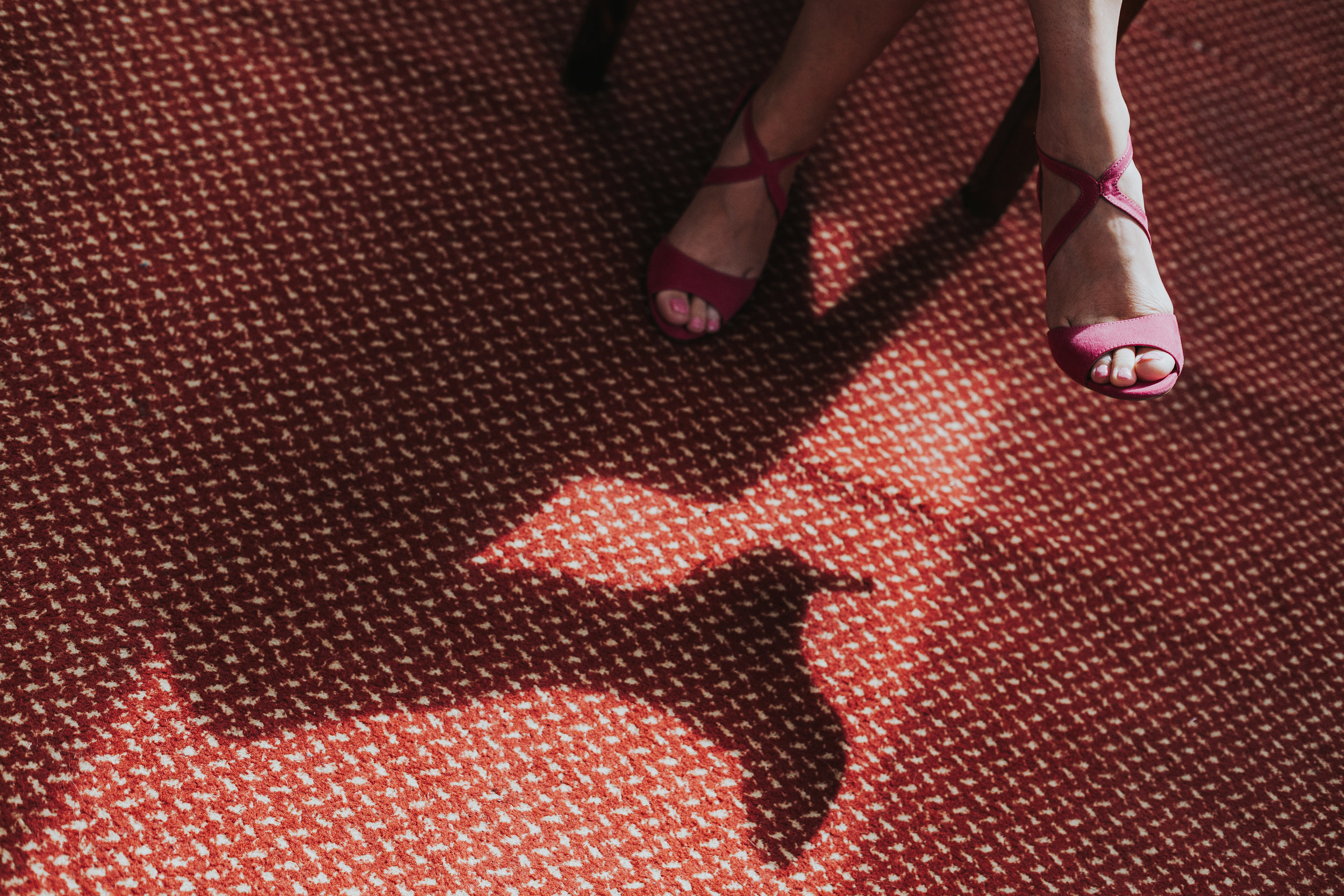 Patch of light with the shadow of a high heeled shoe.