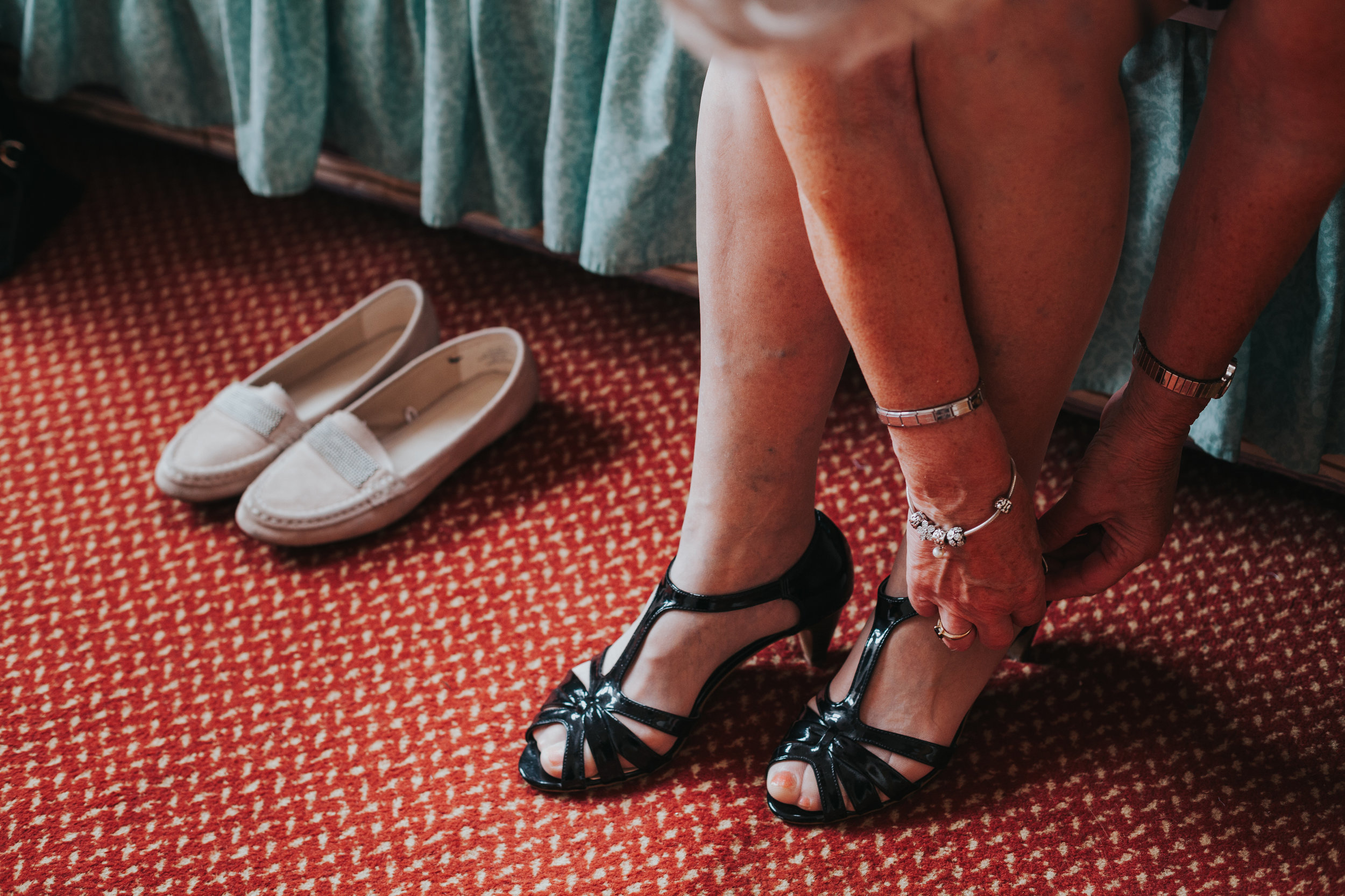 Nan swaps her slippers for her heeled wedding shoes.