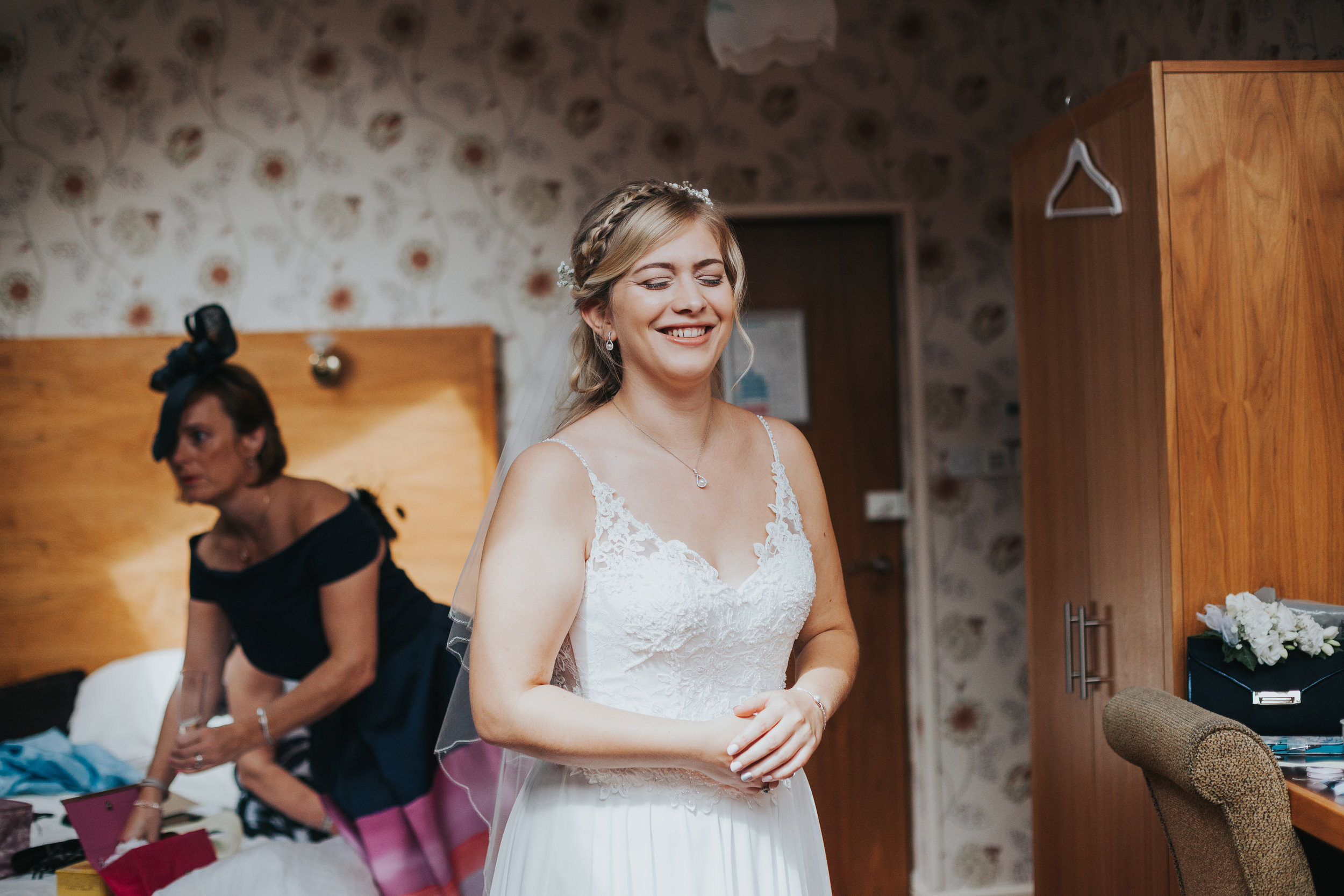 Bride smiling ready to get married at Mytton Fold.