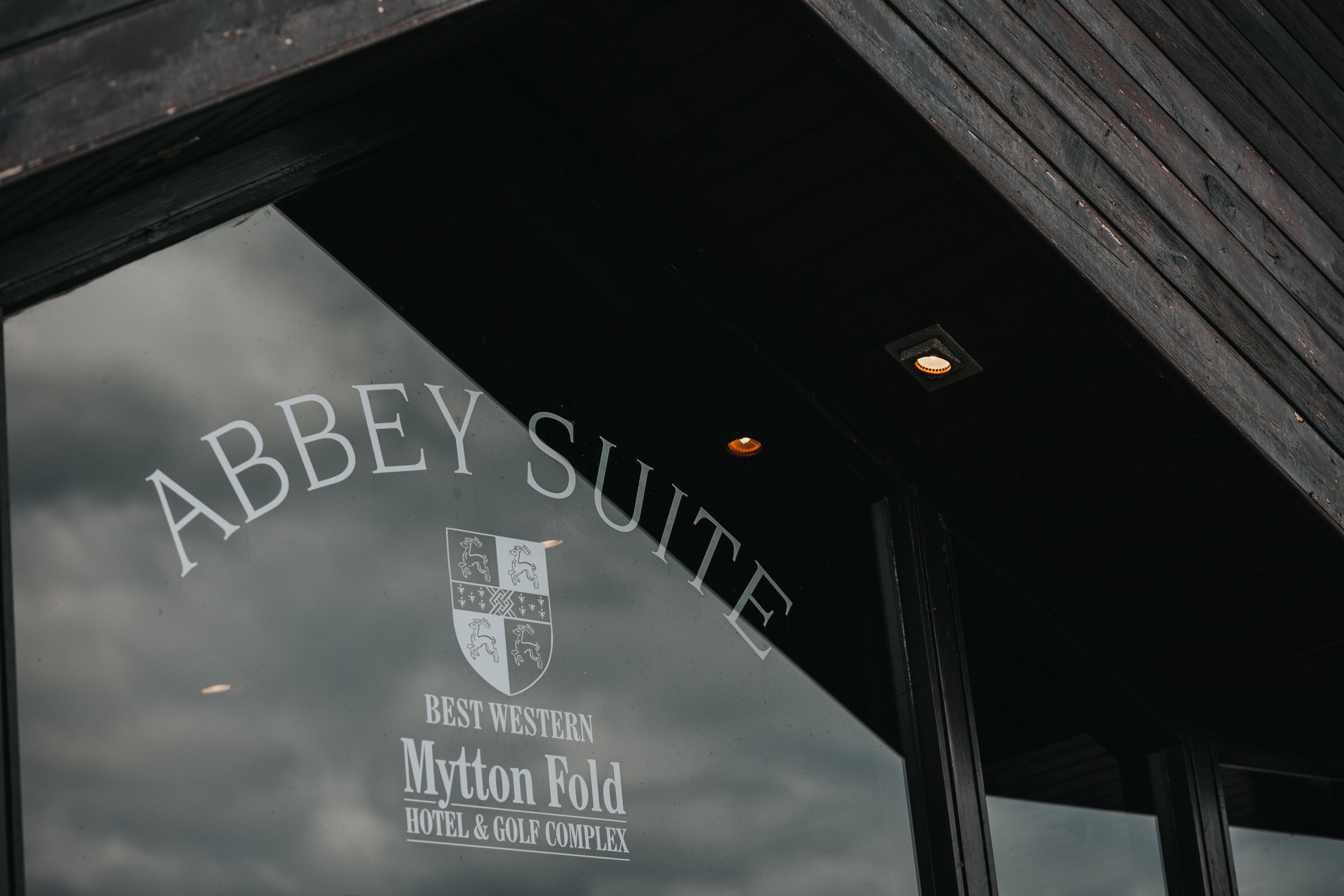 Abbey Suite Mytton Fold etched on a glass window.