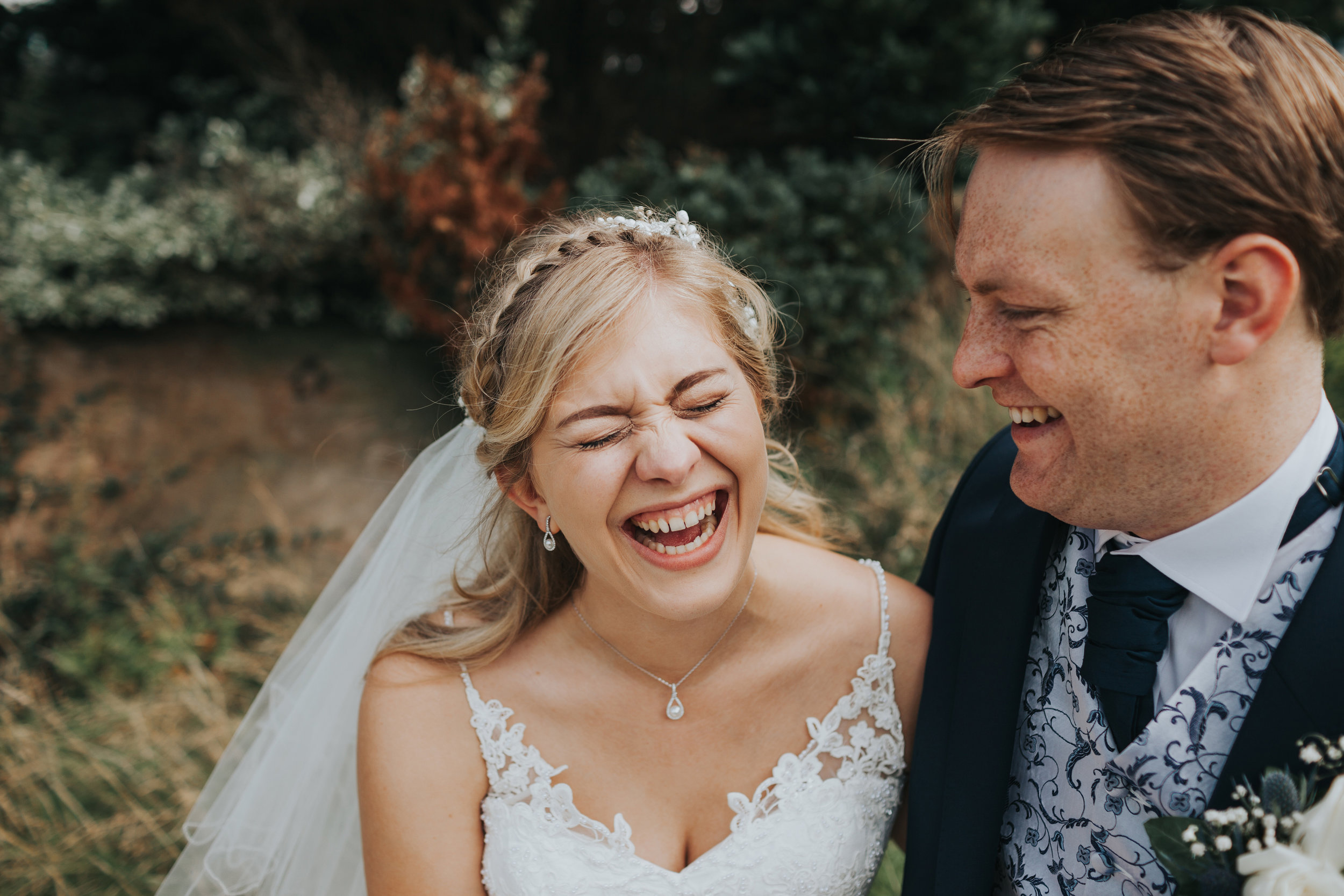 Bride cracks up laughing at Groom.