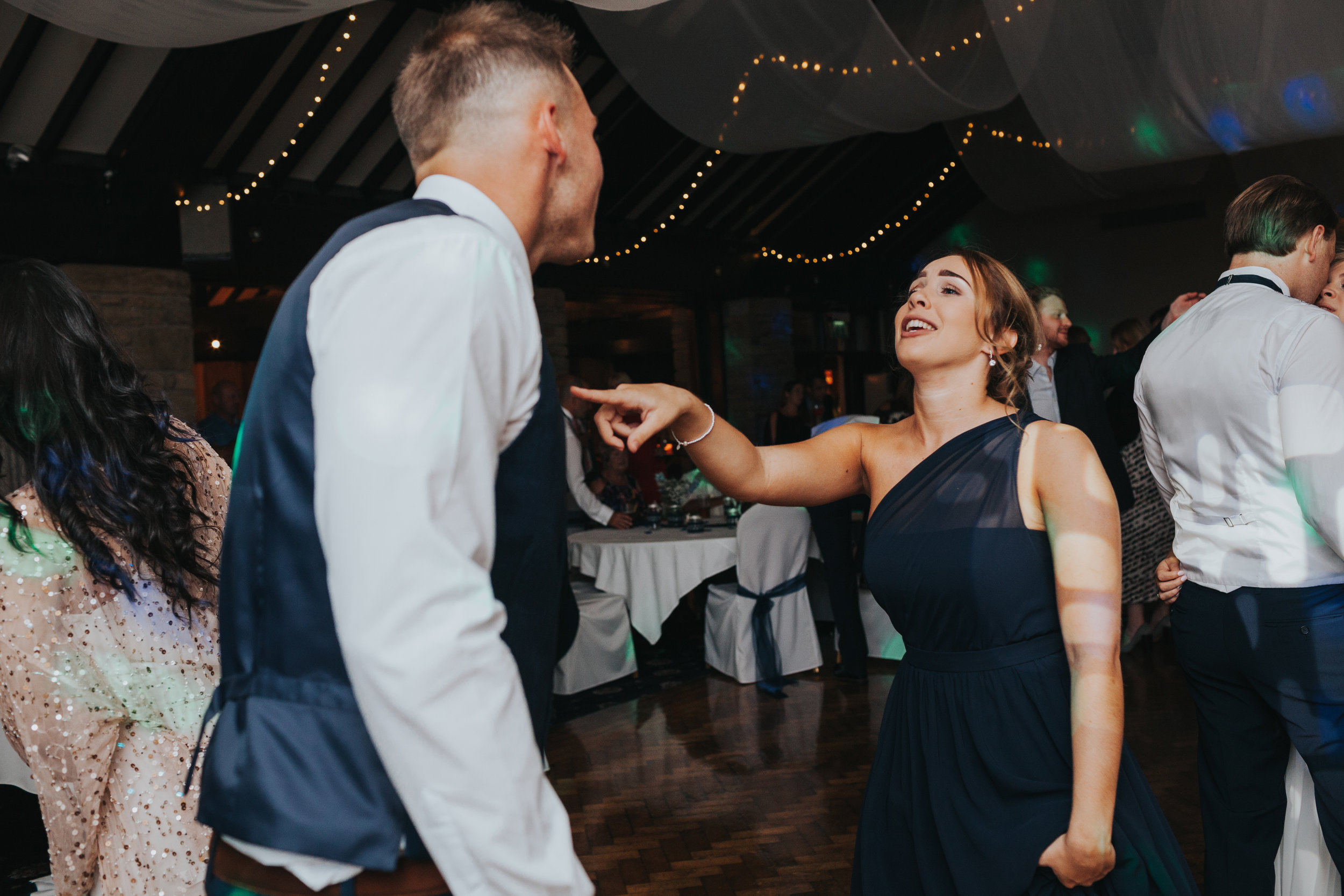 Bridesmaid dances with partner.