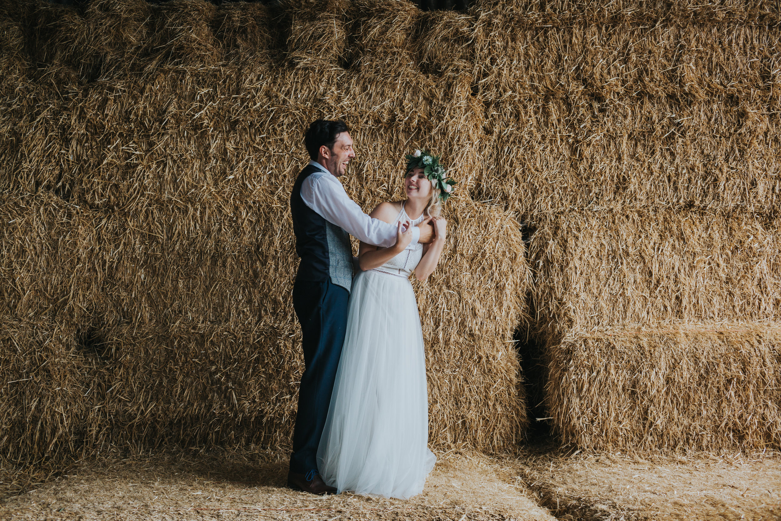Bride and groom larking about at Owen House Wedding Barn.