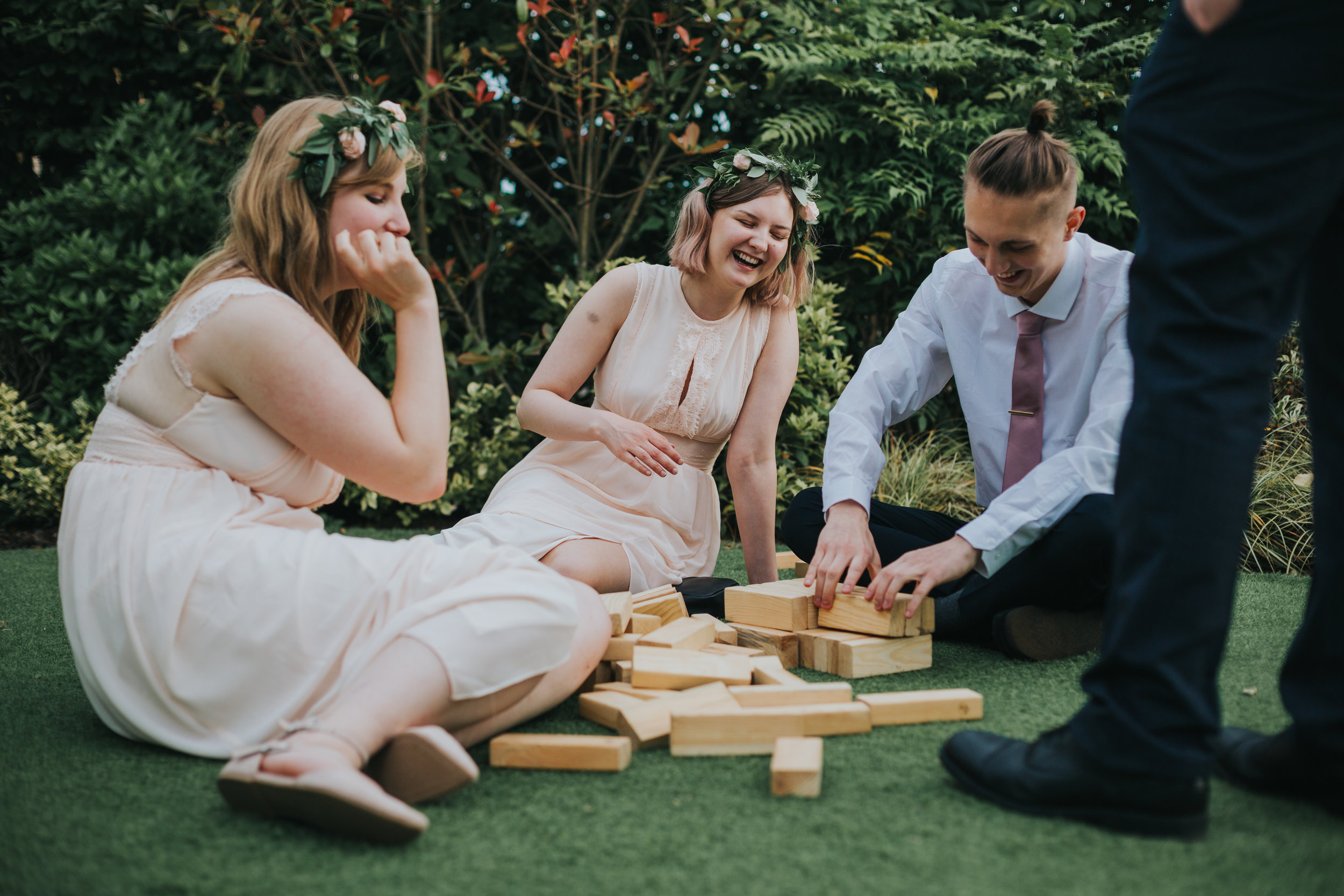Bridesmaids laughing and playing Jenga.