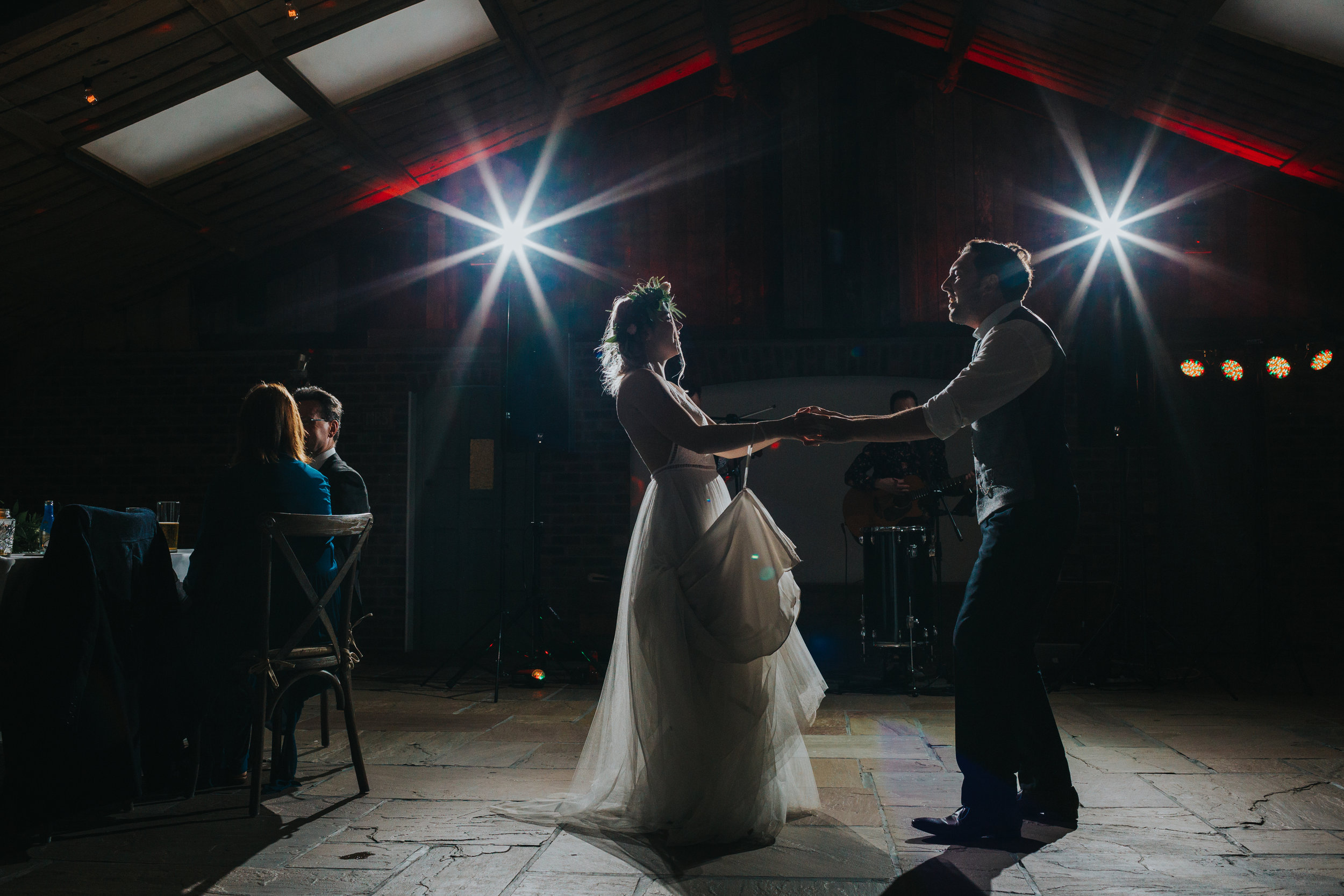Bide and groom dance together at Owen House Wedding Barn.