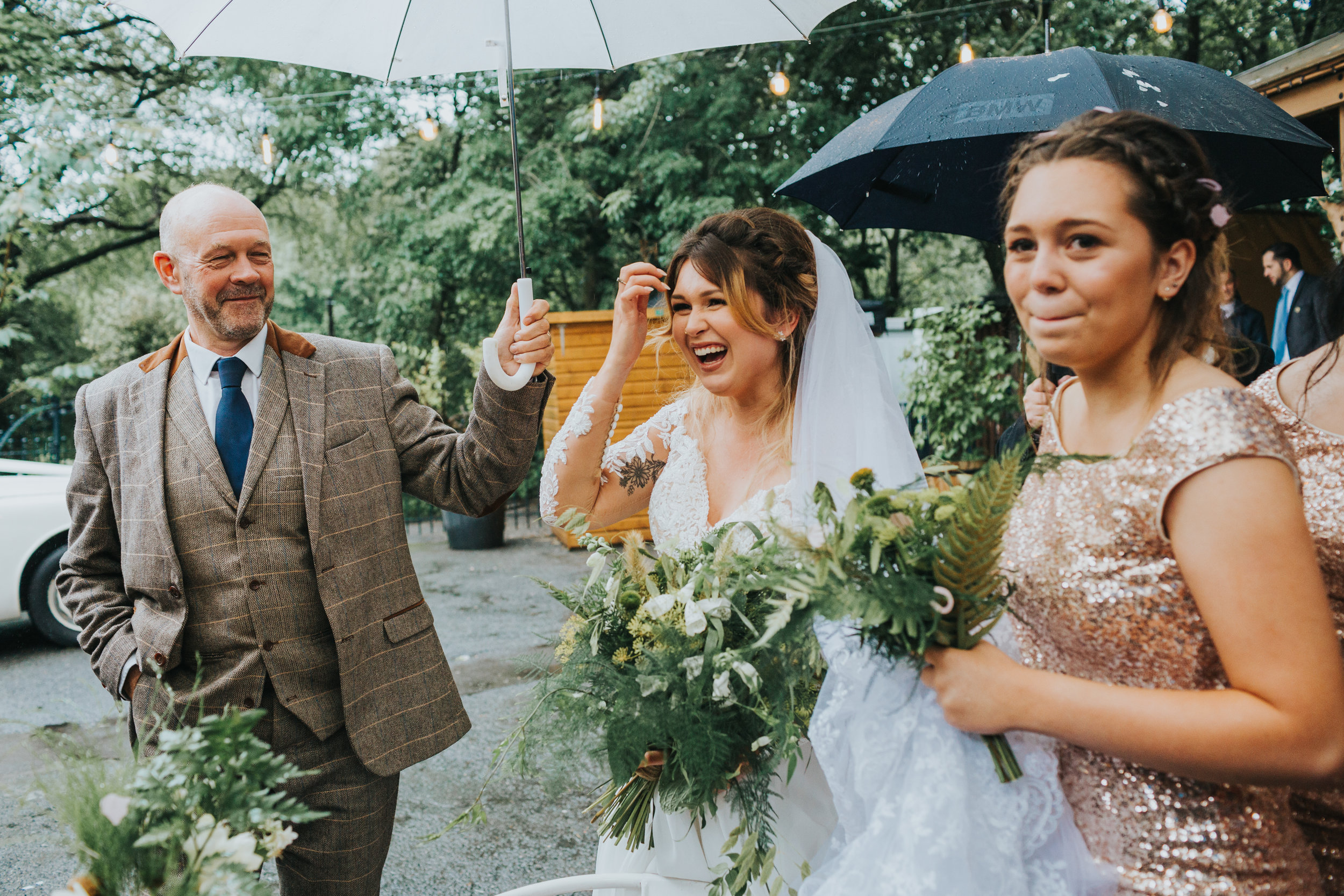 Bride laughs with wedding guests.