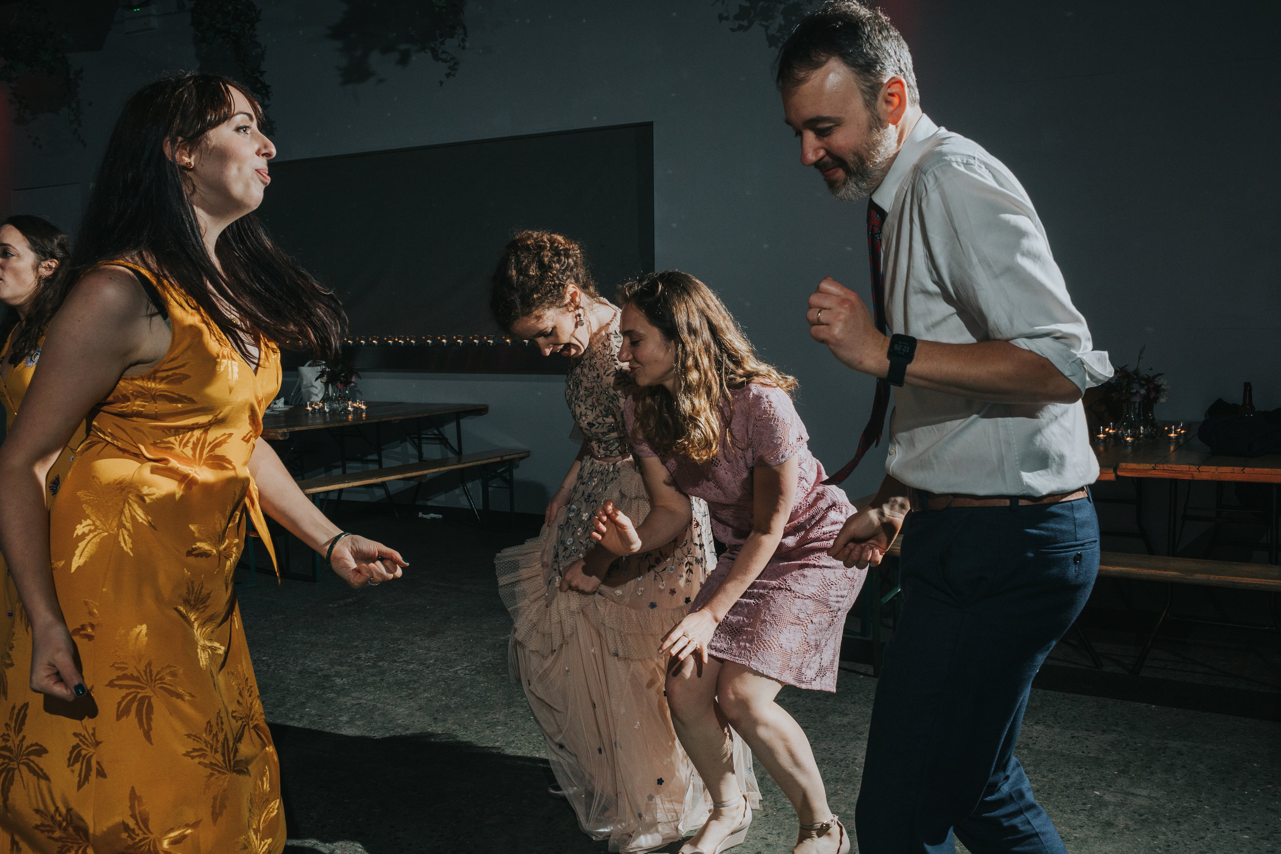 Bride throws some shapes on the dance floor with her mates.