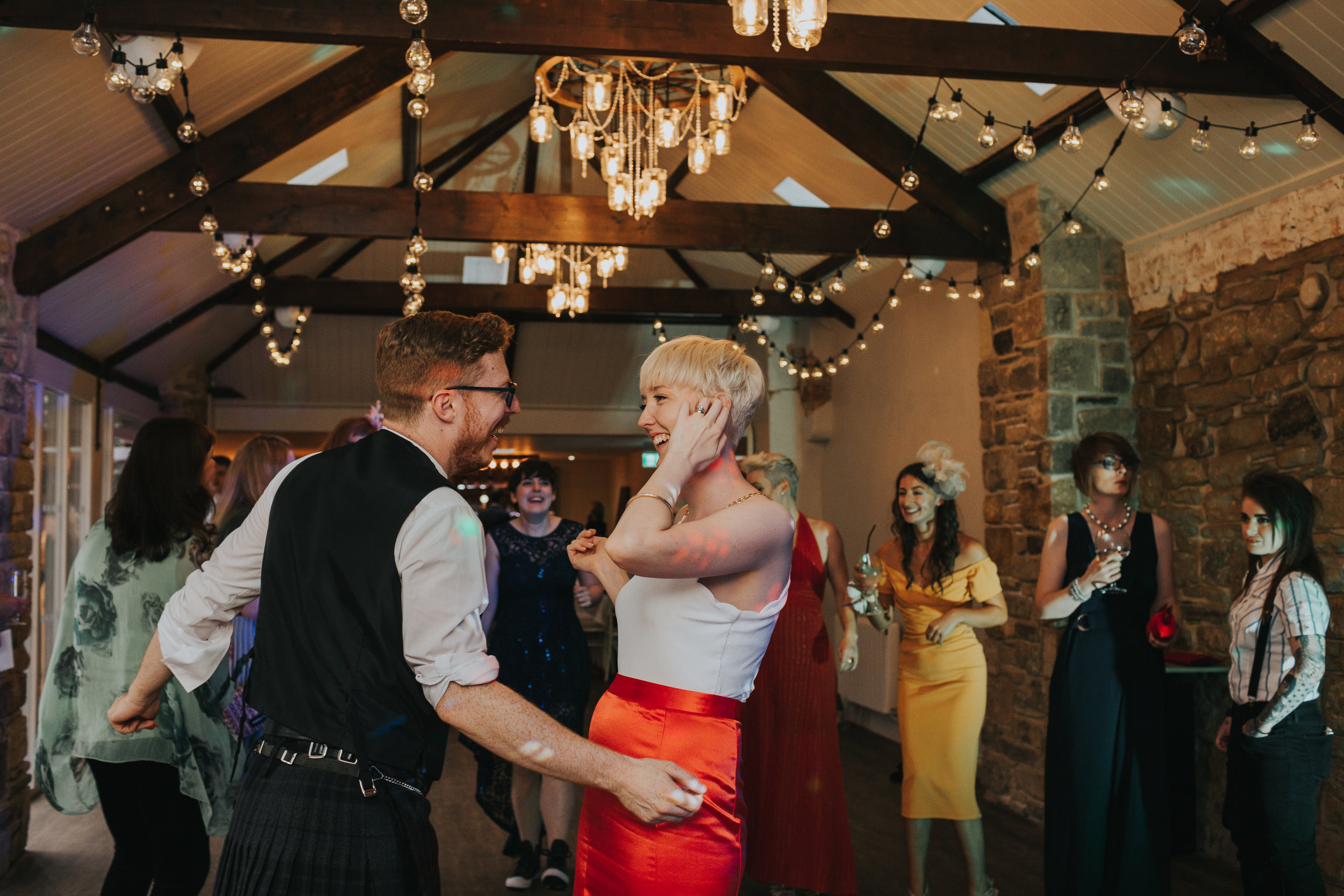 The bride and groom dance laughing together at Shotton Grange.