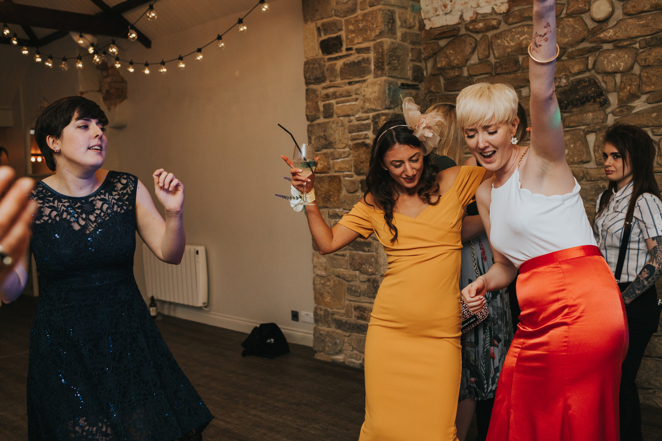 The bride dances with her friends.