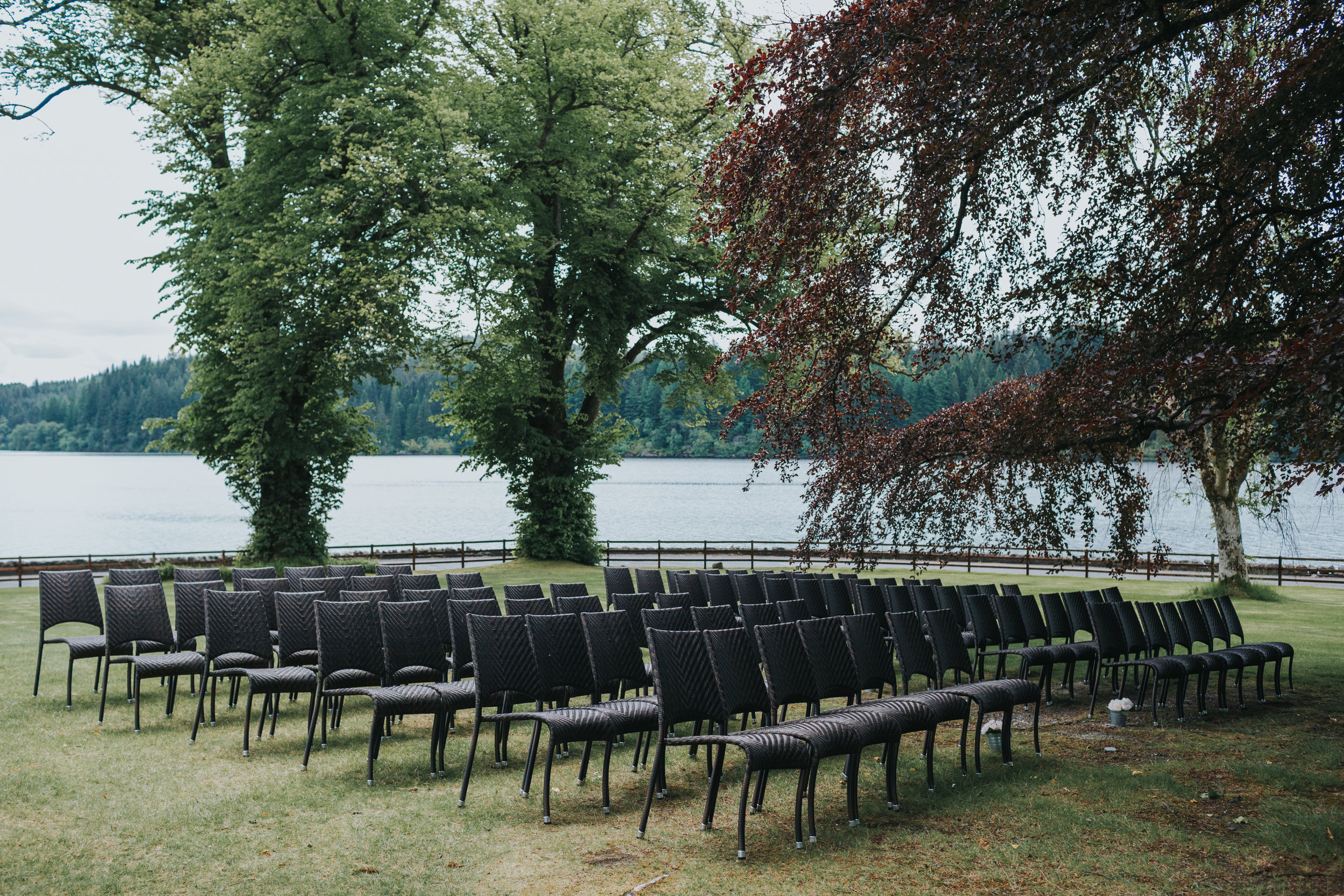 Chairs await wedding guests bottoms under The Beech Tree.