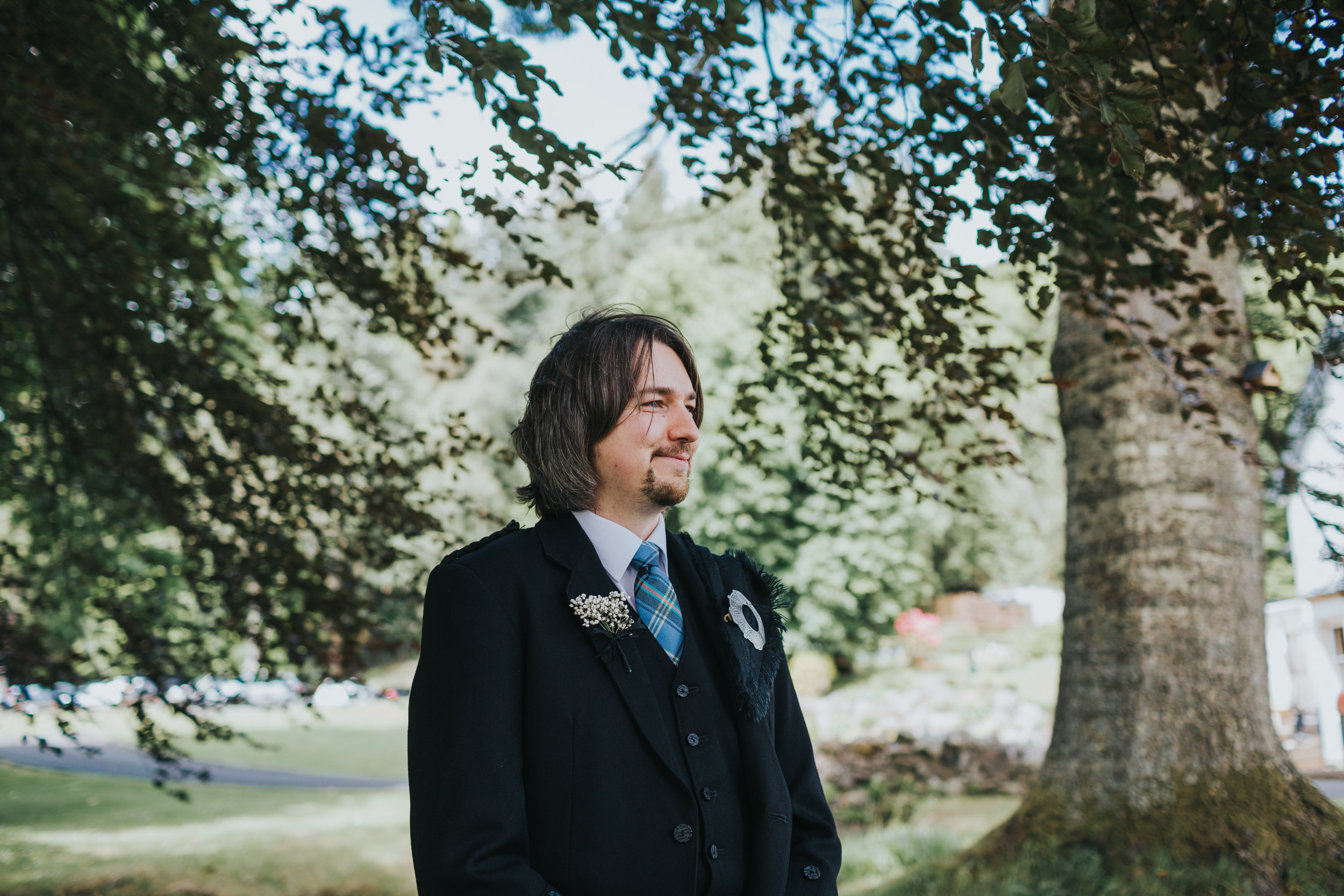 Groom smiles as he watches his bride come down the aisle.