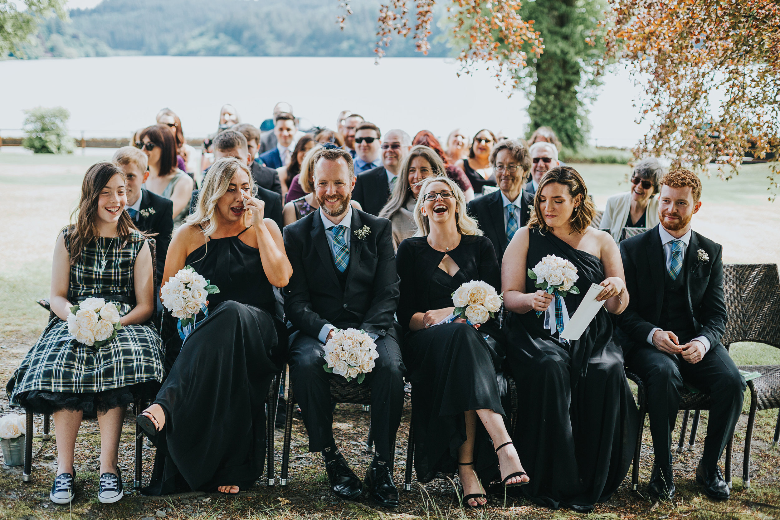 wedding guests fall about laughing.