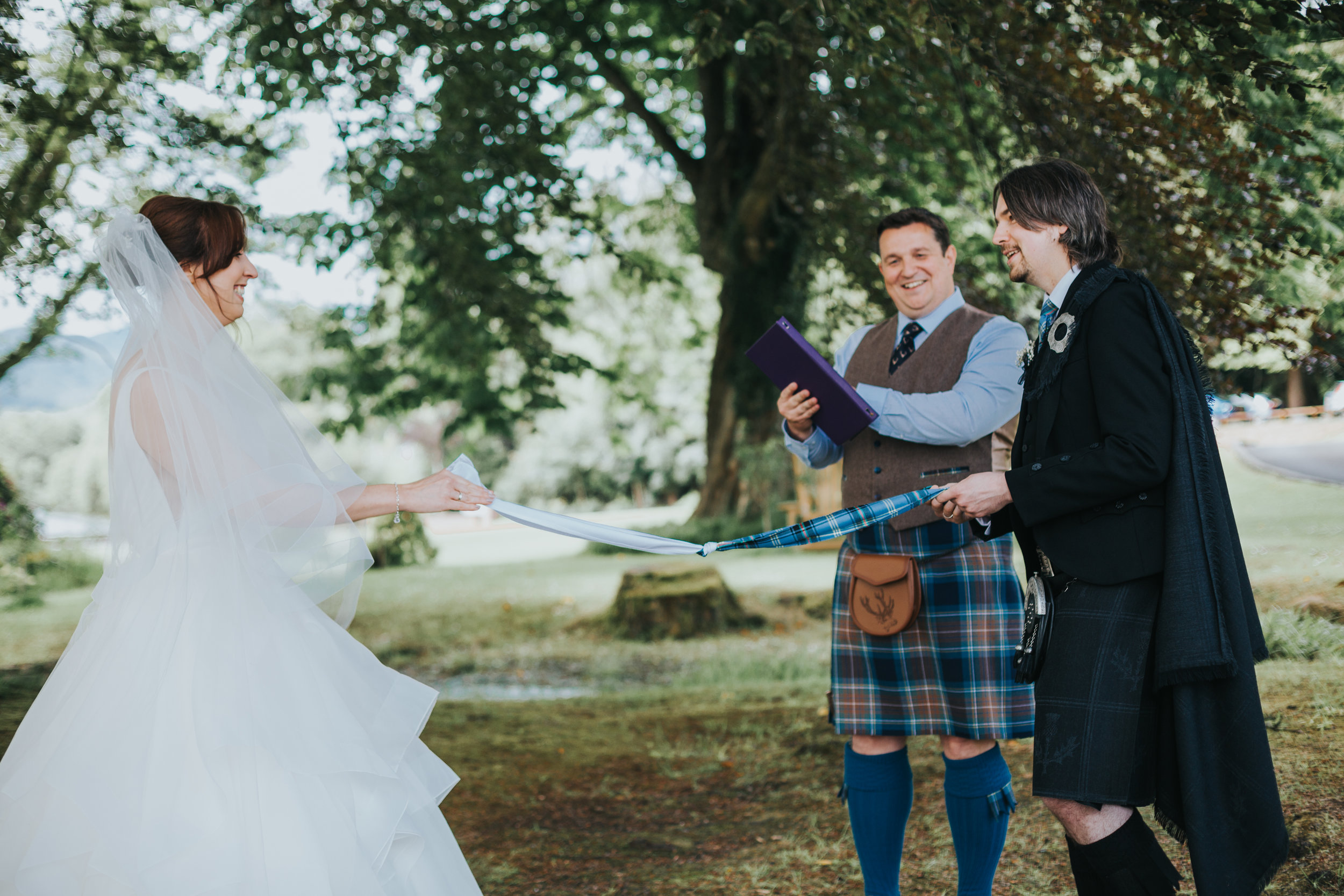 Bride and Groom tie the knot in hand fasting ceremony.