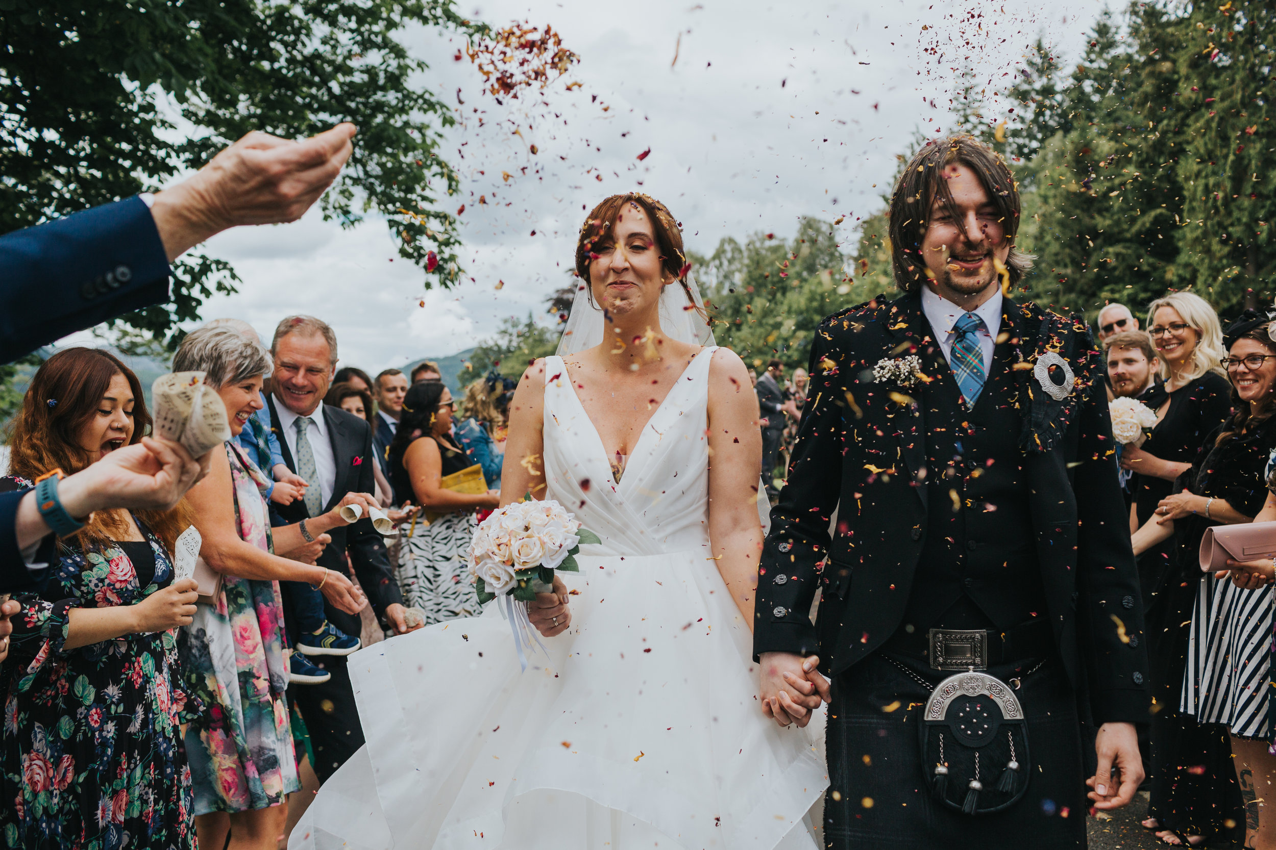Couple get confetti in their face.