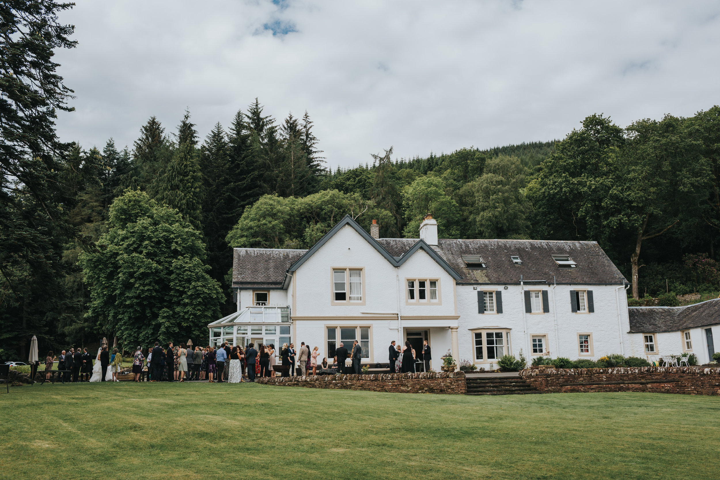 Wedding guests outside Altskeith Country House.