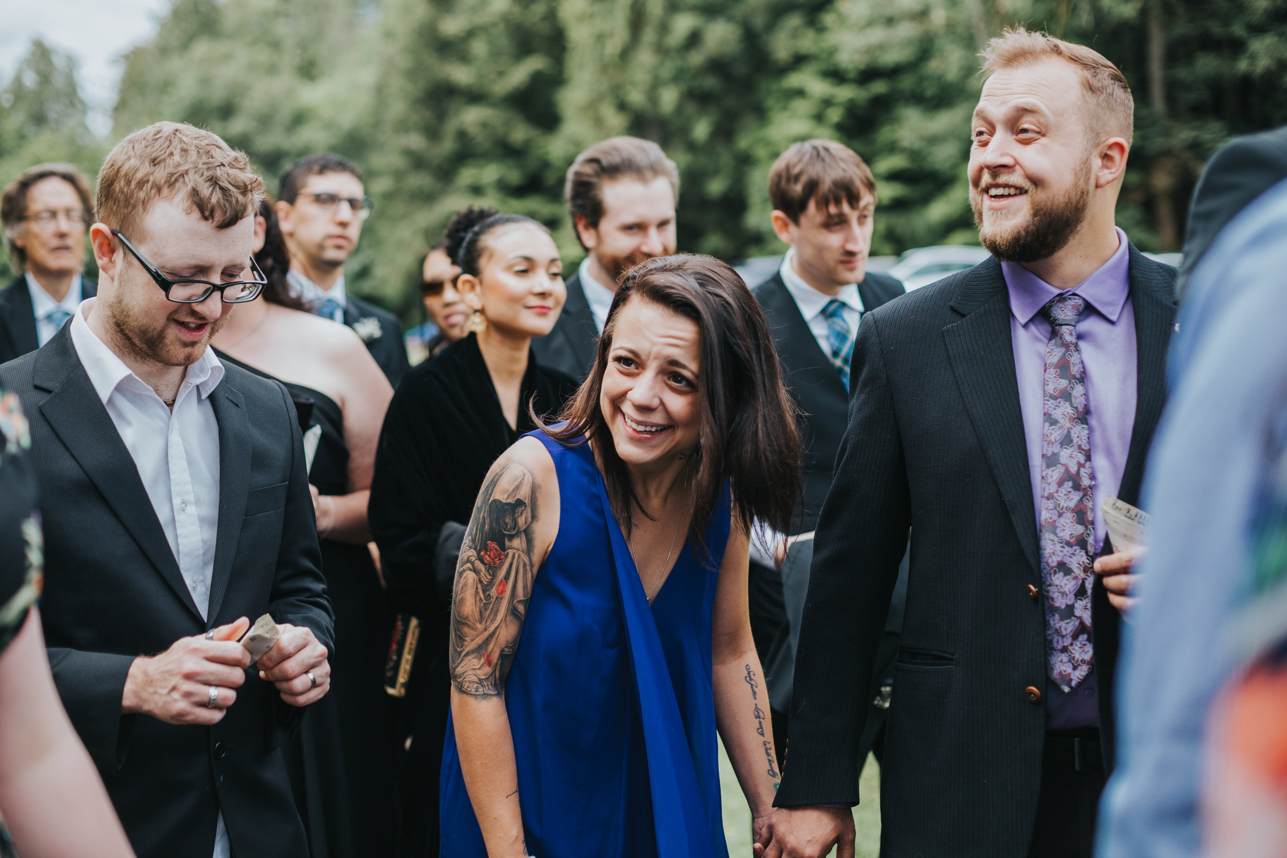 Wedding guests laugh together.