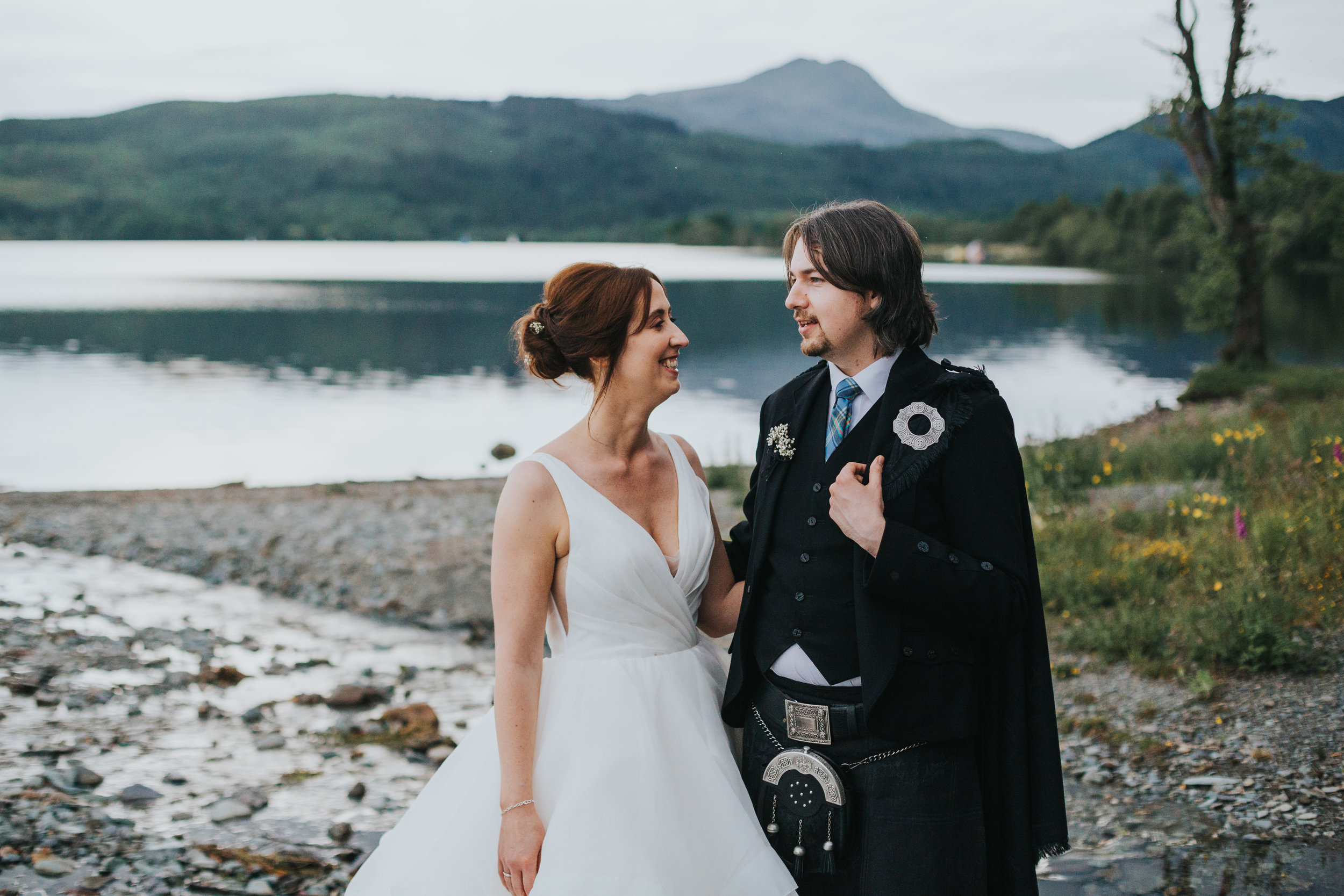 Bride and groom in front of Loch.