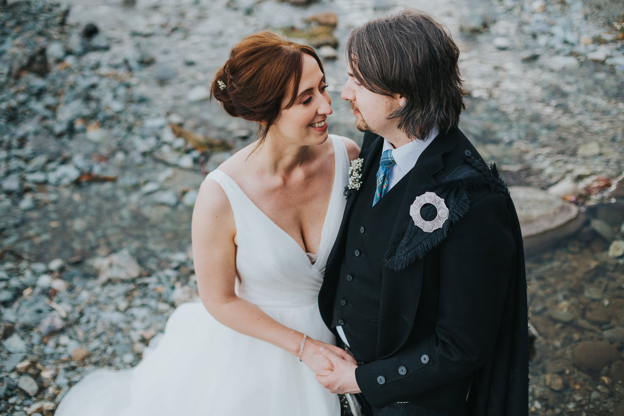 Bride and Groom have a romantic moment together, Loch Ard, Scotland.