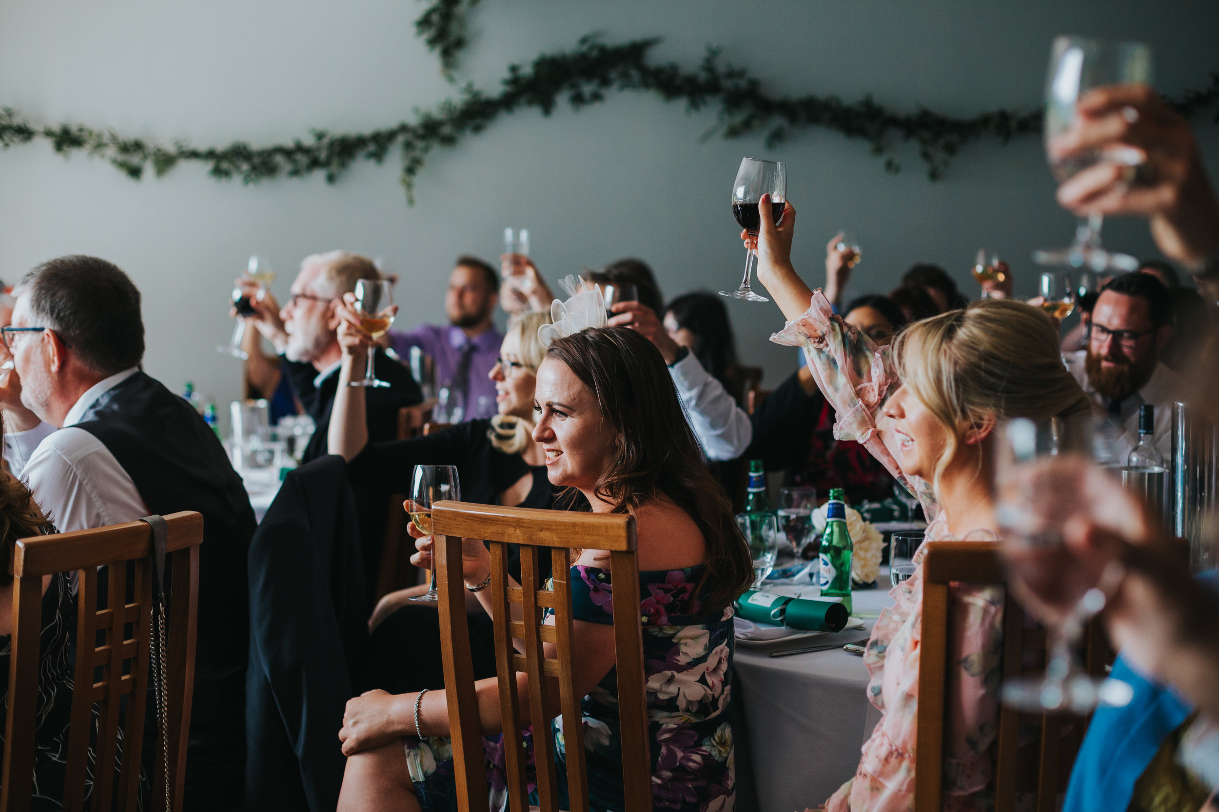 Guests raise their glasses.